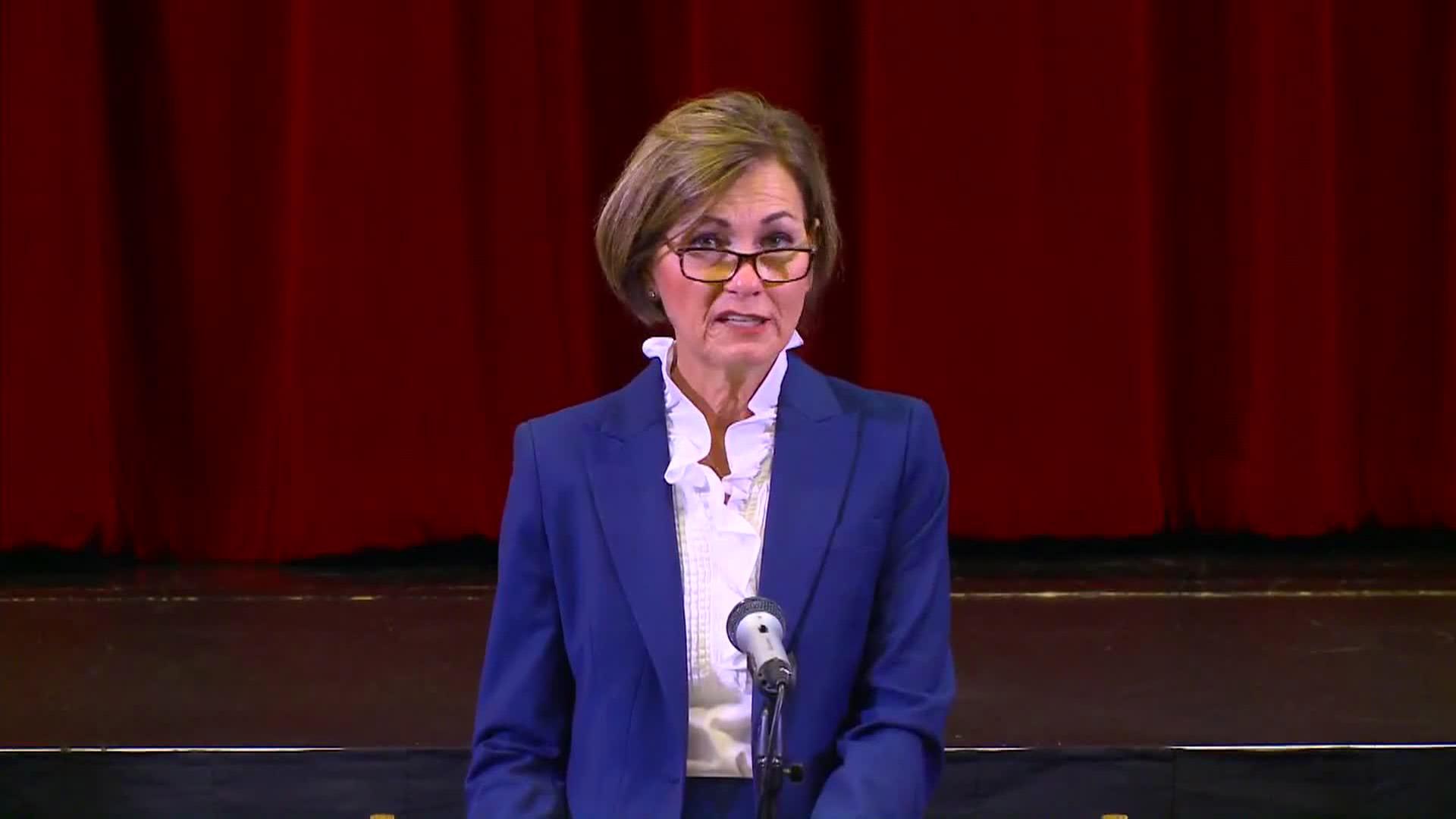 Iowa Gov. Kim Reynolds speaks during a press conference in Van Meter, Iowa, on July 17.