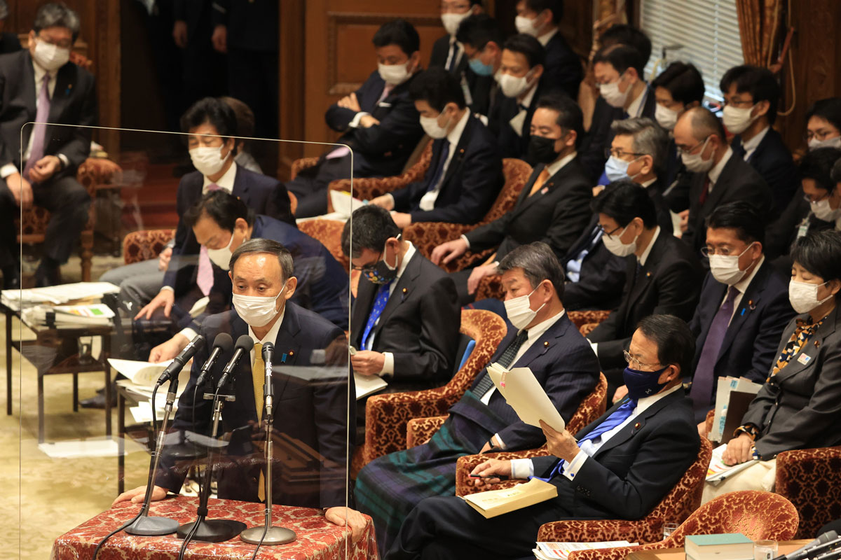 Japanese Prime Minister Yoshihide Suga answers a question at the Lower House's budget committee session in Tokyo on January 26.
