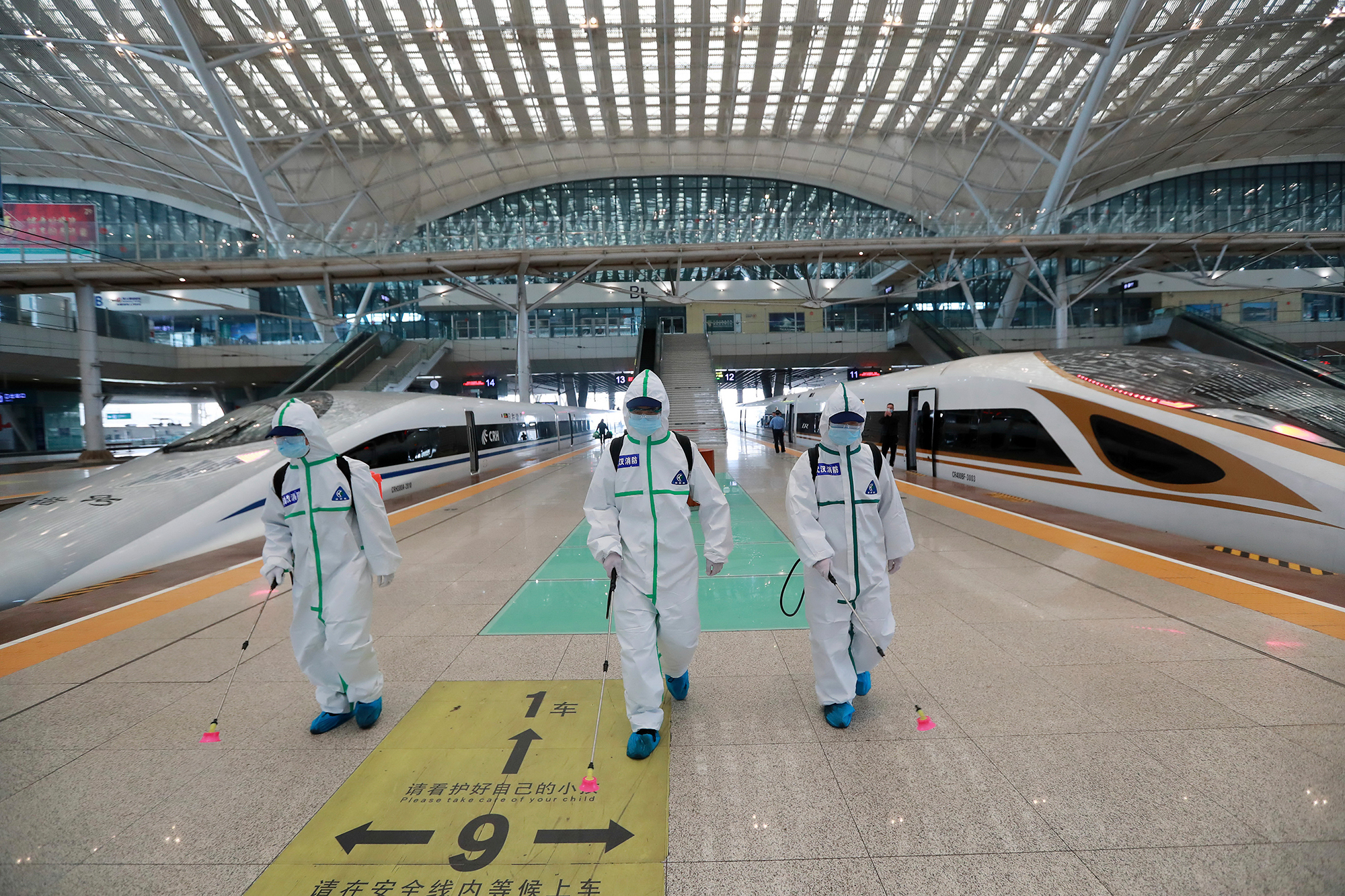 In this photo released by Xinhua News Agency, firefighters conduct disinfection on the platform of Wuhan Railway Station in Wuhan, central China's Hubei Province, on March 24.