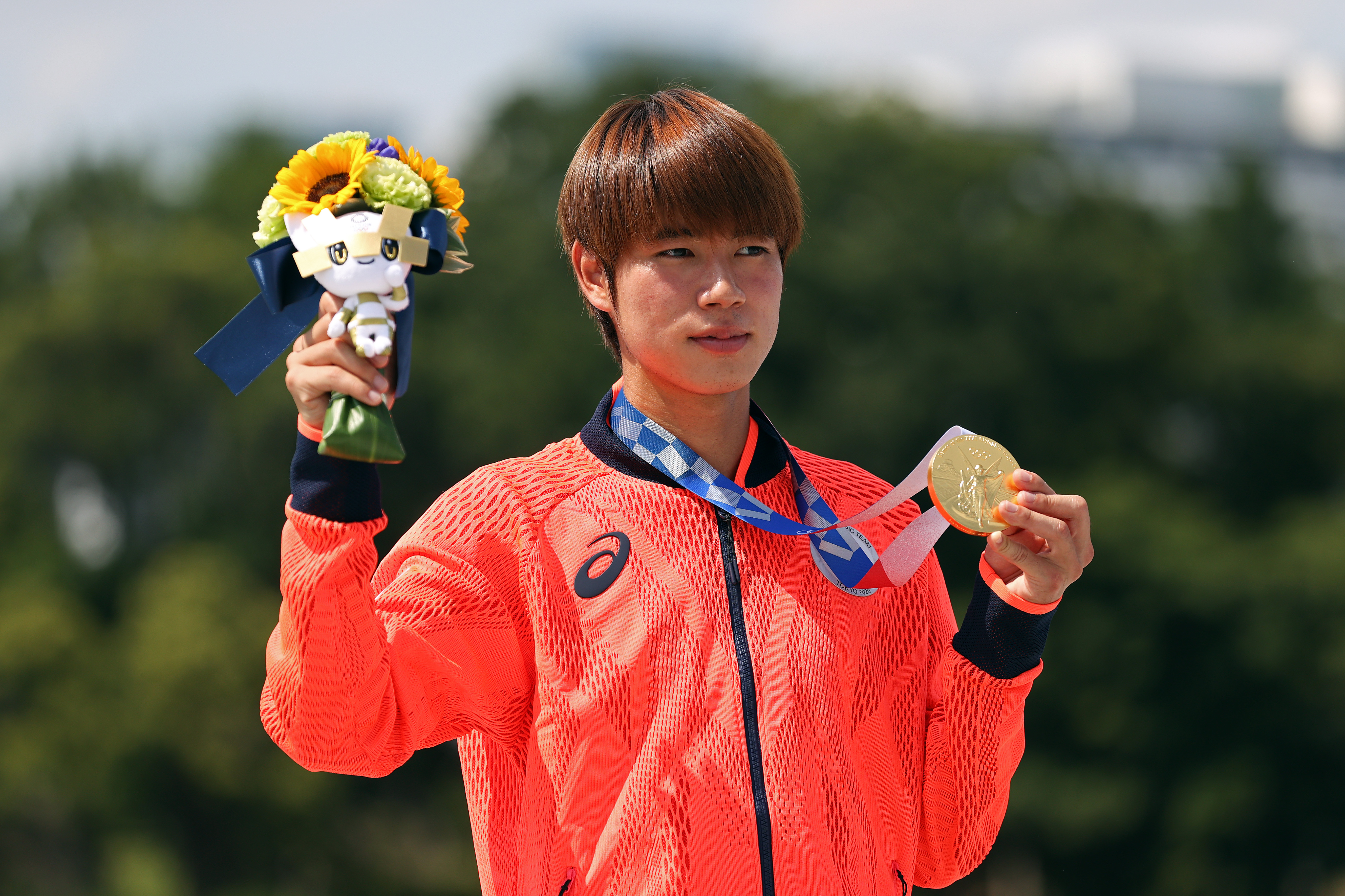 Yuto Horigome of Team Japan poses with his gold medal at the Skateboarding Men's Street Finals medal ceremony on July 25, in Tokyo, Japan.