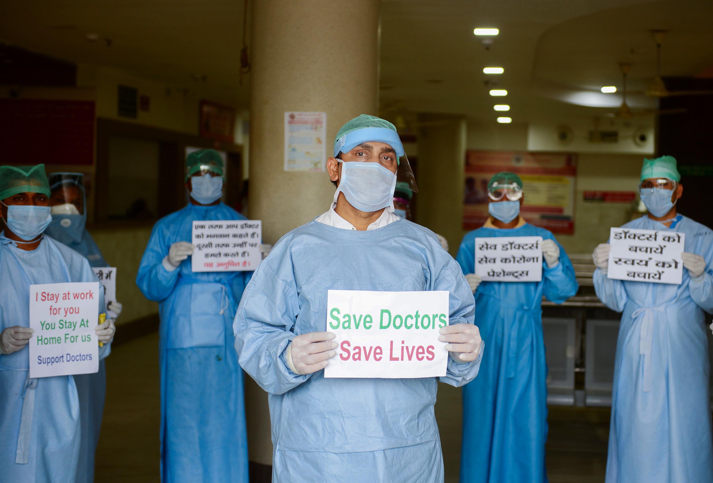 Doctors and medical staff of Narayan Swaroop Hospital in Allahabad hold placards on April 16 to protest against recent assaults on health care workers in India.