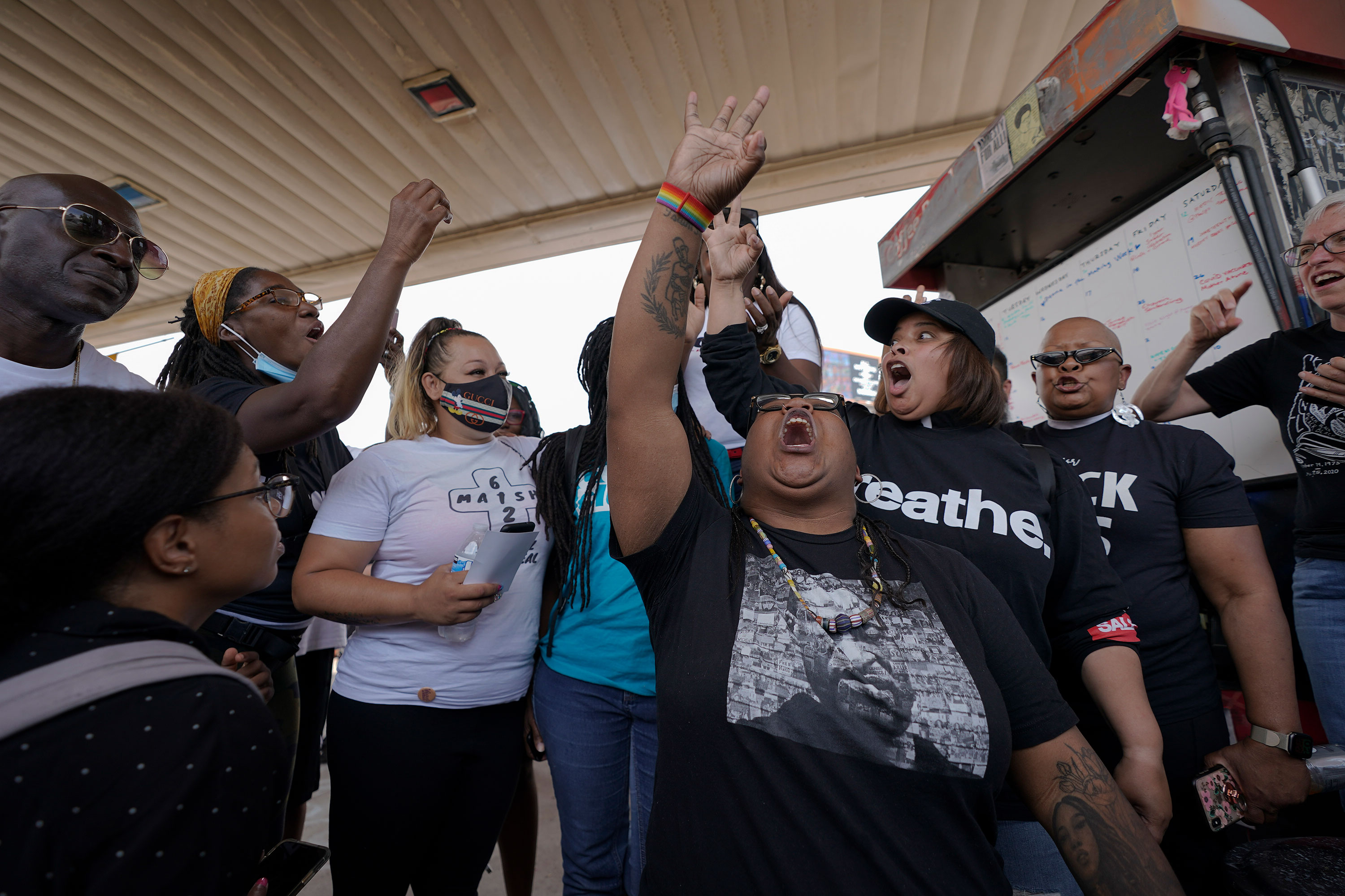 Jennifer Starr Dodd, center, holds up three fingers to symbolize the three other police officers still to be tried, as supporters react to the sentencing of former Minneapolis police Officer Derek Chauvin for the murder of George Floyd on Friday, June 25, at George Floyd Square in Minneapolis.