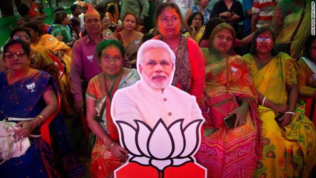 Bharatiya Janata Party (BJP) supporters celebrate with a cutout of Prime Minister Narendra Modi at their party office in Gauhati, India, Thursday.