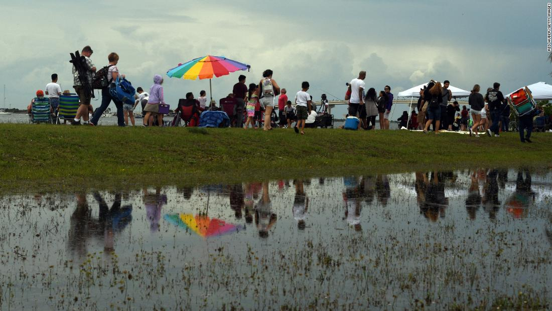 People who had gathered to watch Wednesday's SpaceX launch leave Marina Park in Titusville, Florida after it was scrubbed.