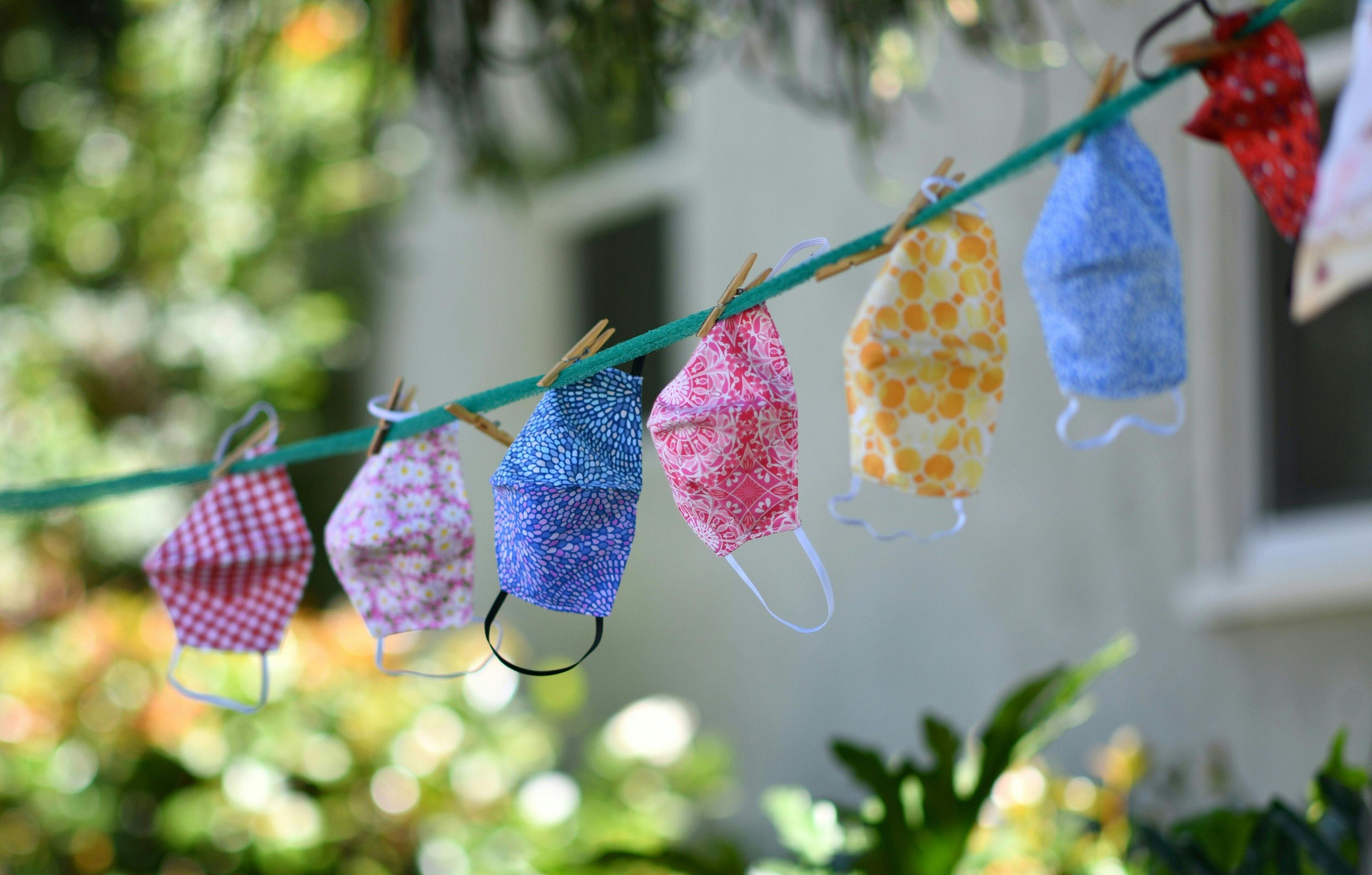 Makes for sale are displayed on a clothesline outside a residence in Los Angeles, California, on July 20, 2020.