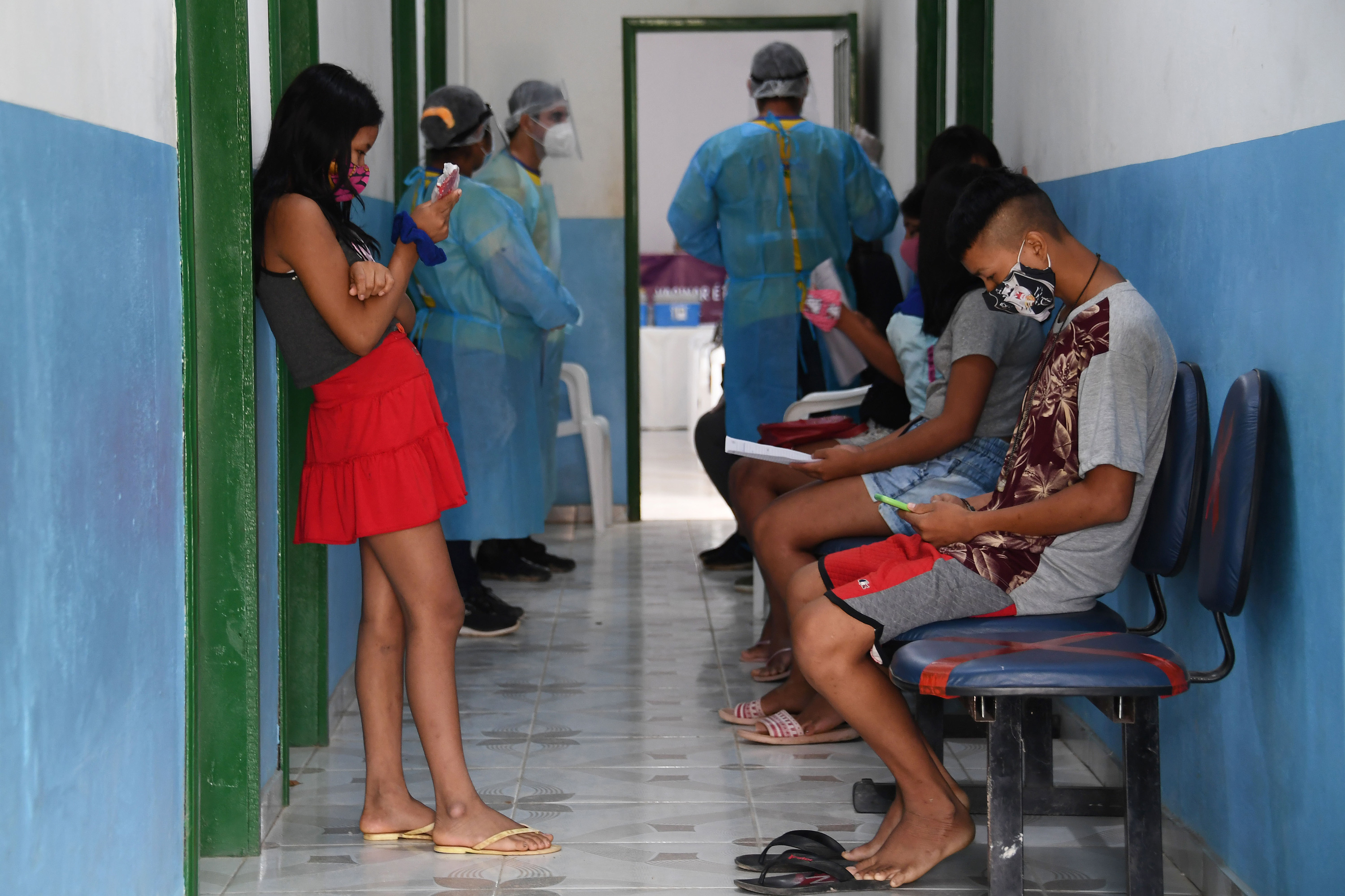 Brazilian indigenous people of the Marubo ethnic group wait to see doctors from the Brazilian Armed Forces' medical team at a health post in Amazonas state.
