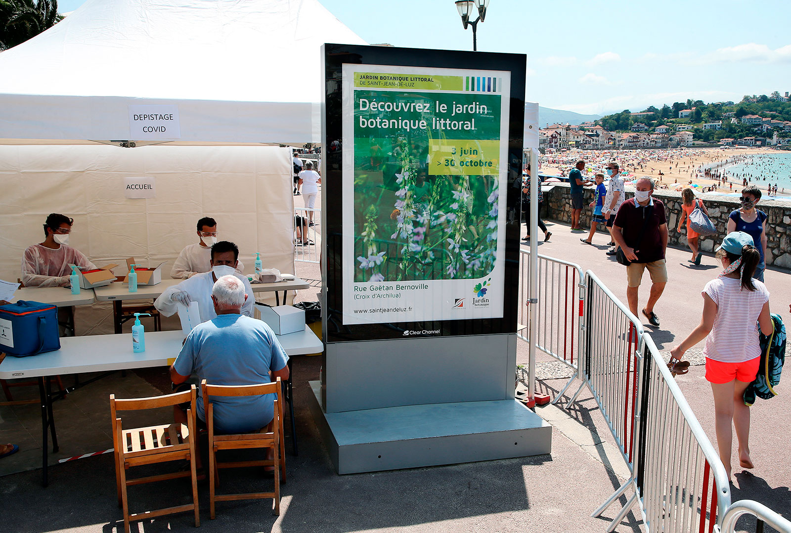 Healthcare workers prepare to administer coronavirus tests to people in Saint-Jean-de-Luz, France, on Monday, July 27.