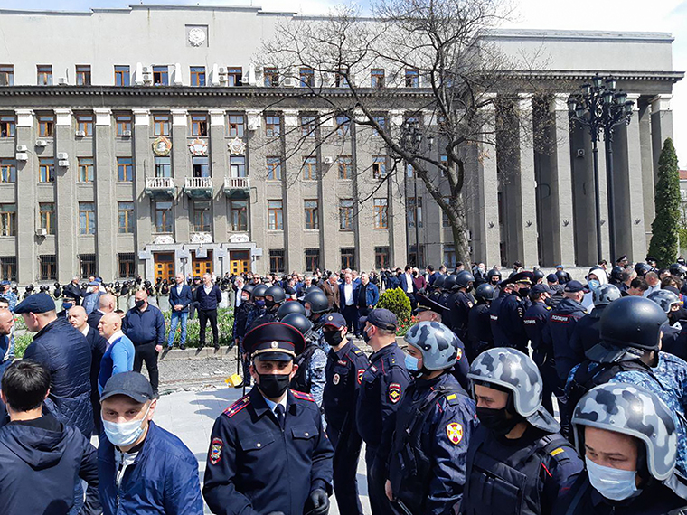 Law enforcement officers and people taking part in a protest against the self-isolation order in Svobody Square in Vladikavkaz, Russia on Monday, April 20.