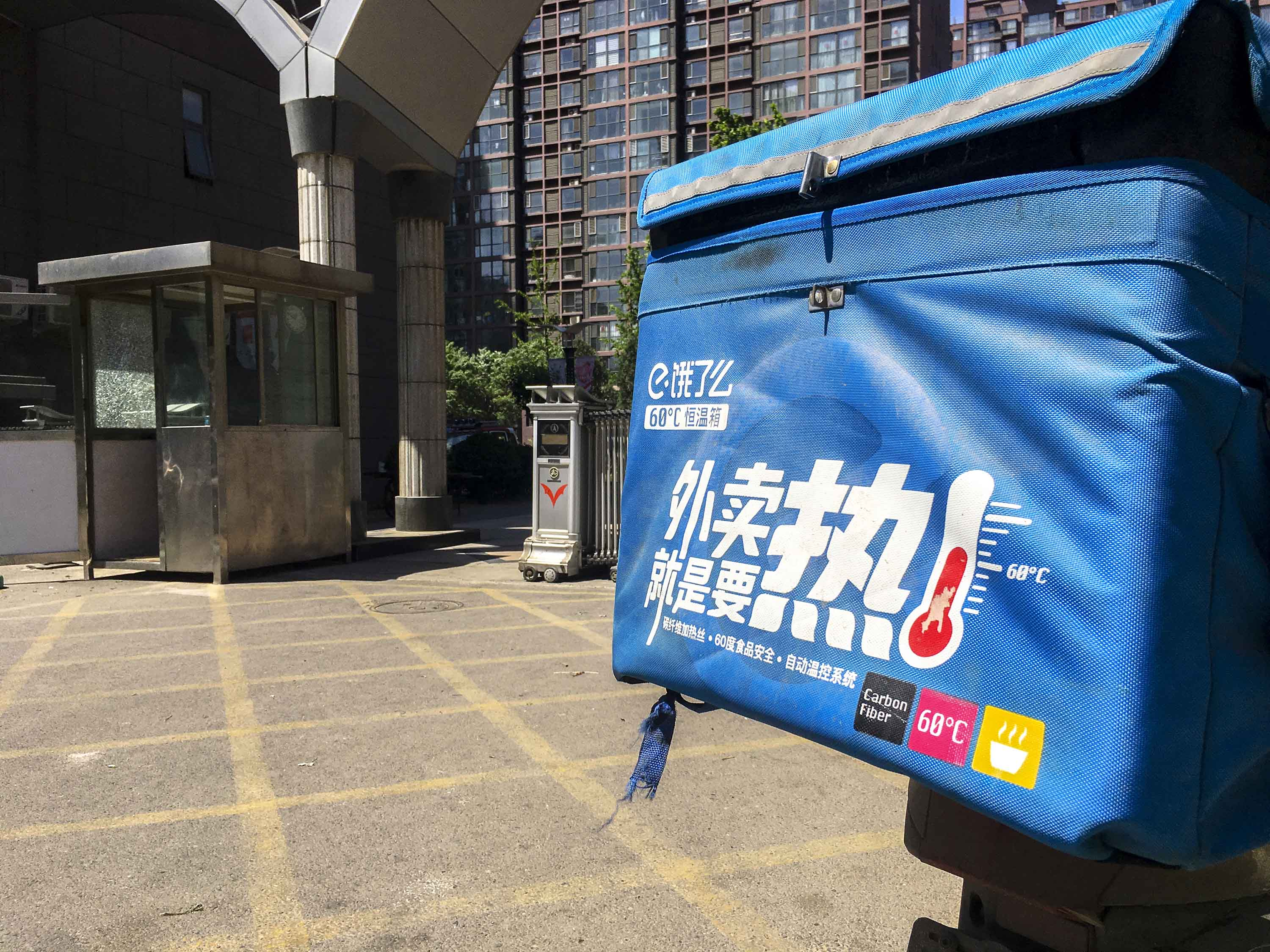 A motorcycle for take-out delivery service Ele.me is seen parked in a residential district of Beijing, in May 2017.
