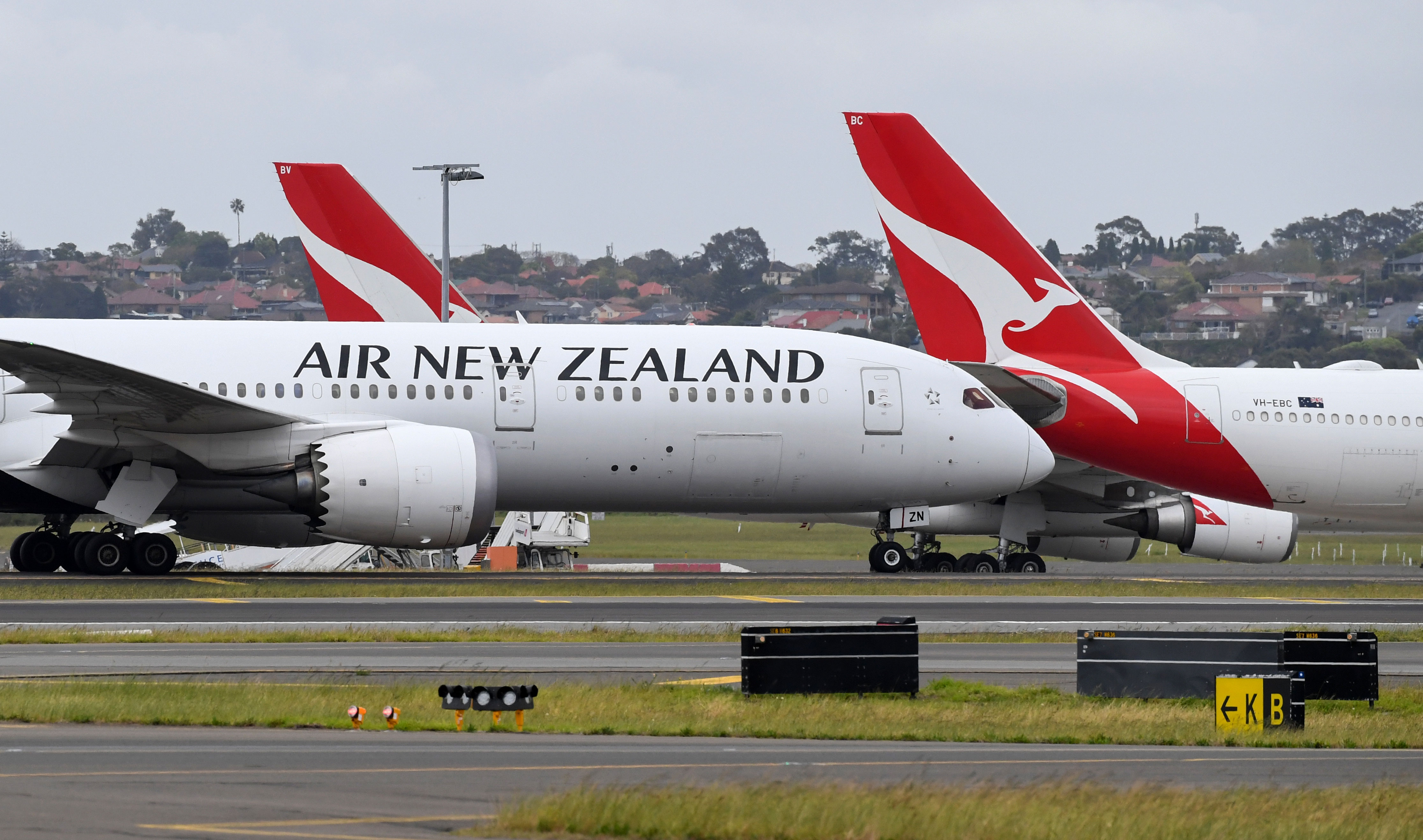 An Air New Zealand flight taxis after it landed at Sydney International Airport in Australia on September 18.