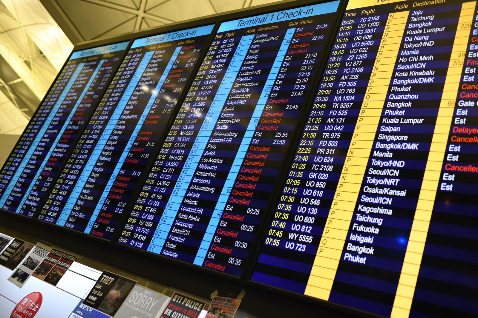 Check-in boards showing canceled flights at Hong Kong airport on August 13, 2019.