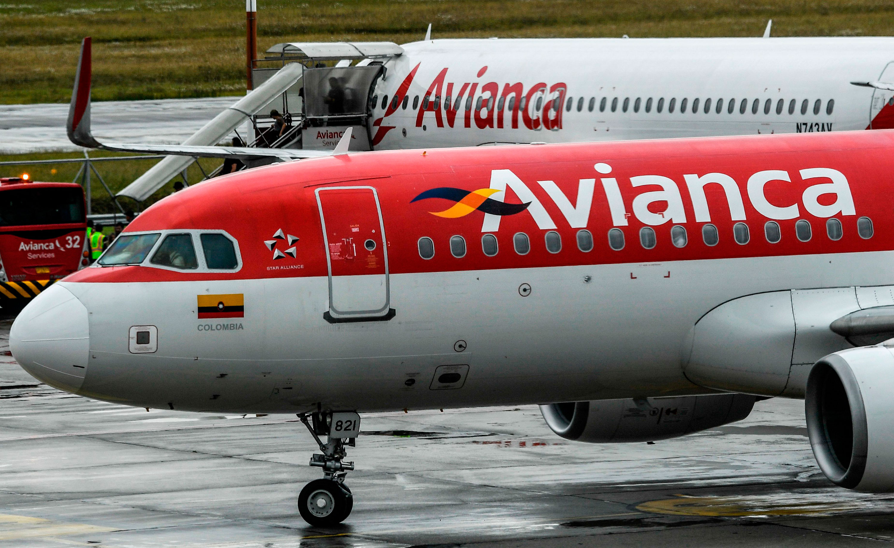 Aircraft of Colombian airline Avianca are seen on the tarmac at El Dorado International Airport in Bogota on August 28, 2019.