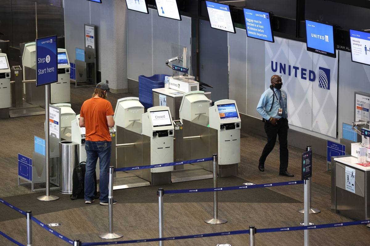 A United Airlines passenger checks in for a flight at San Francisco International Airport on September 02.