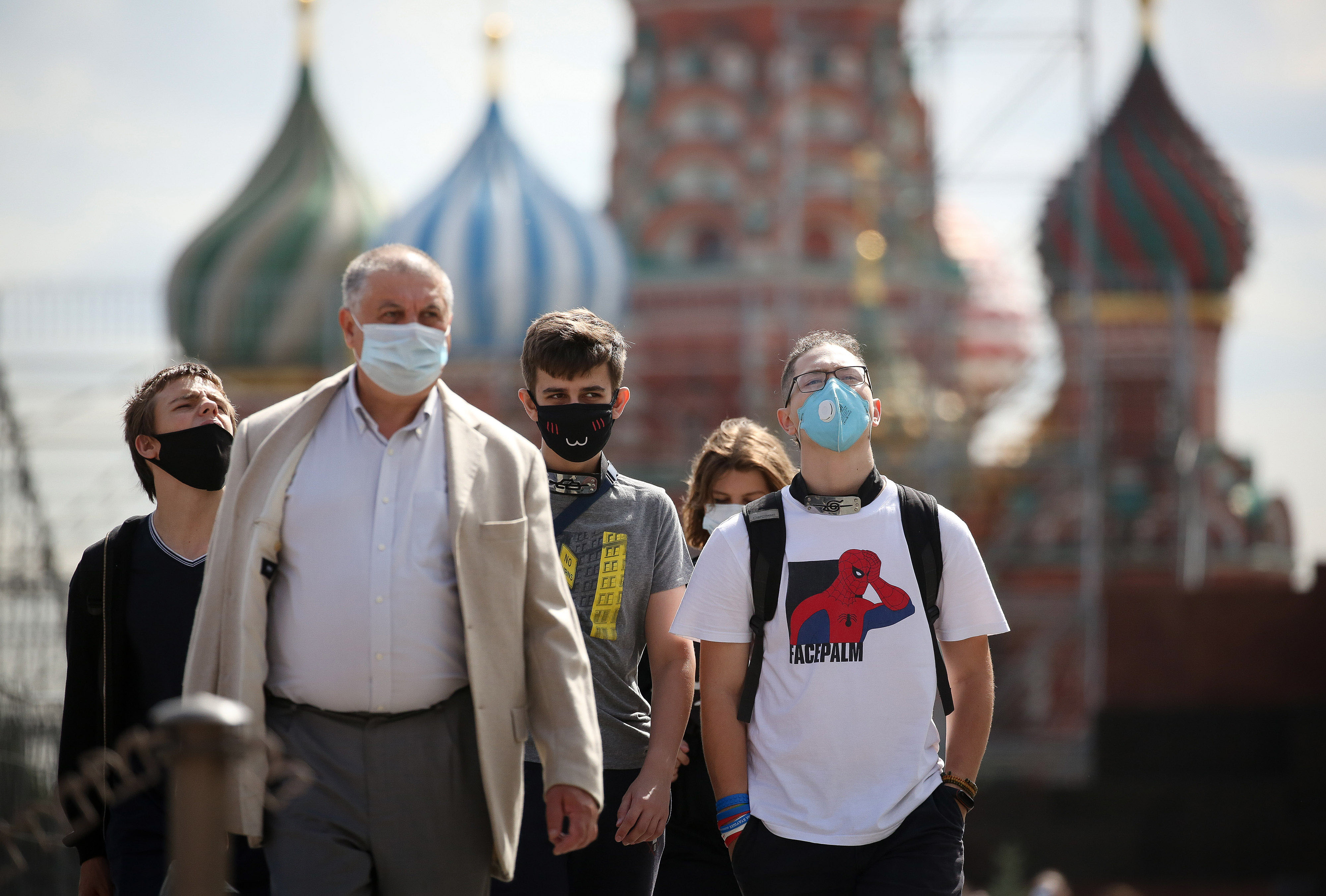 People walk by Moscow's Red Square on August 11.