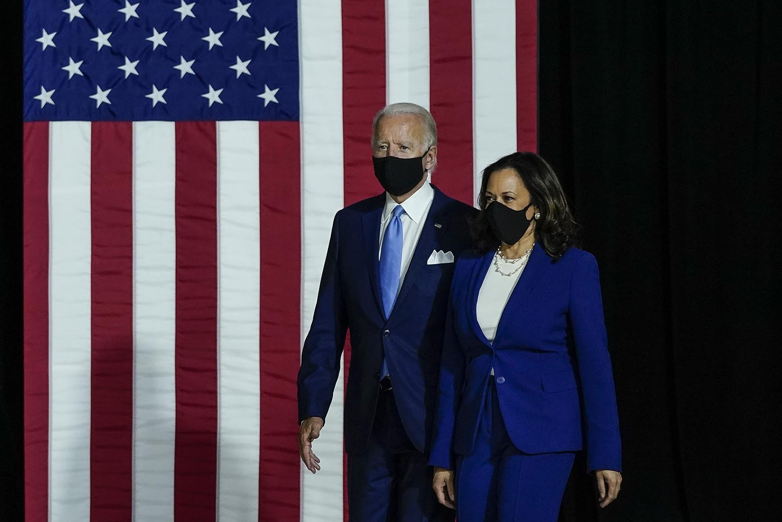 Democratic presidential nominee Joe Biden and his running mate Sen. Kamala Harris arrive to deliver remarks at the Alexis Dupont High School on August 12, in Wilmington, Delaware.