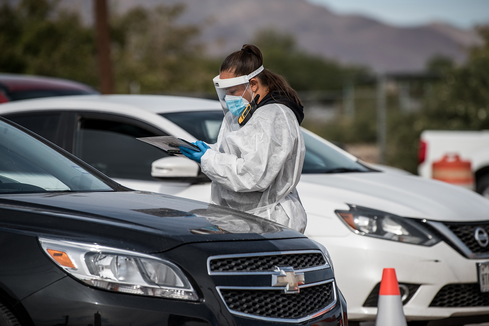 An attendant talks to a person waiting in their car at a Covid-19 testing site at Ascarate Park in El Paso, Texas, on October 31.