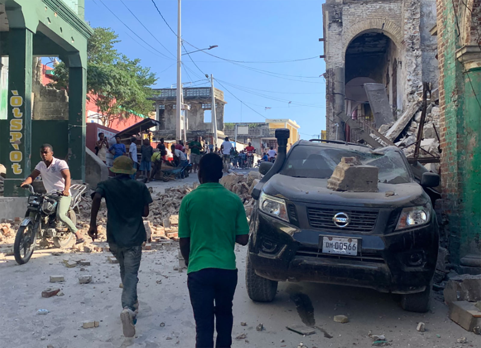 People navigate through the rubble in Les Cayes, Haiti, on August 14.