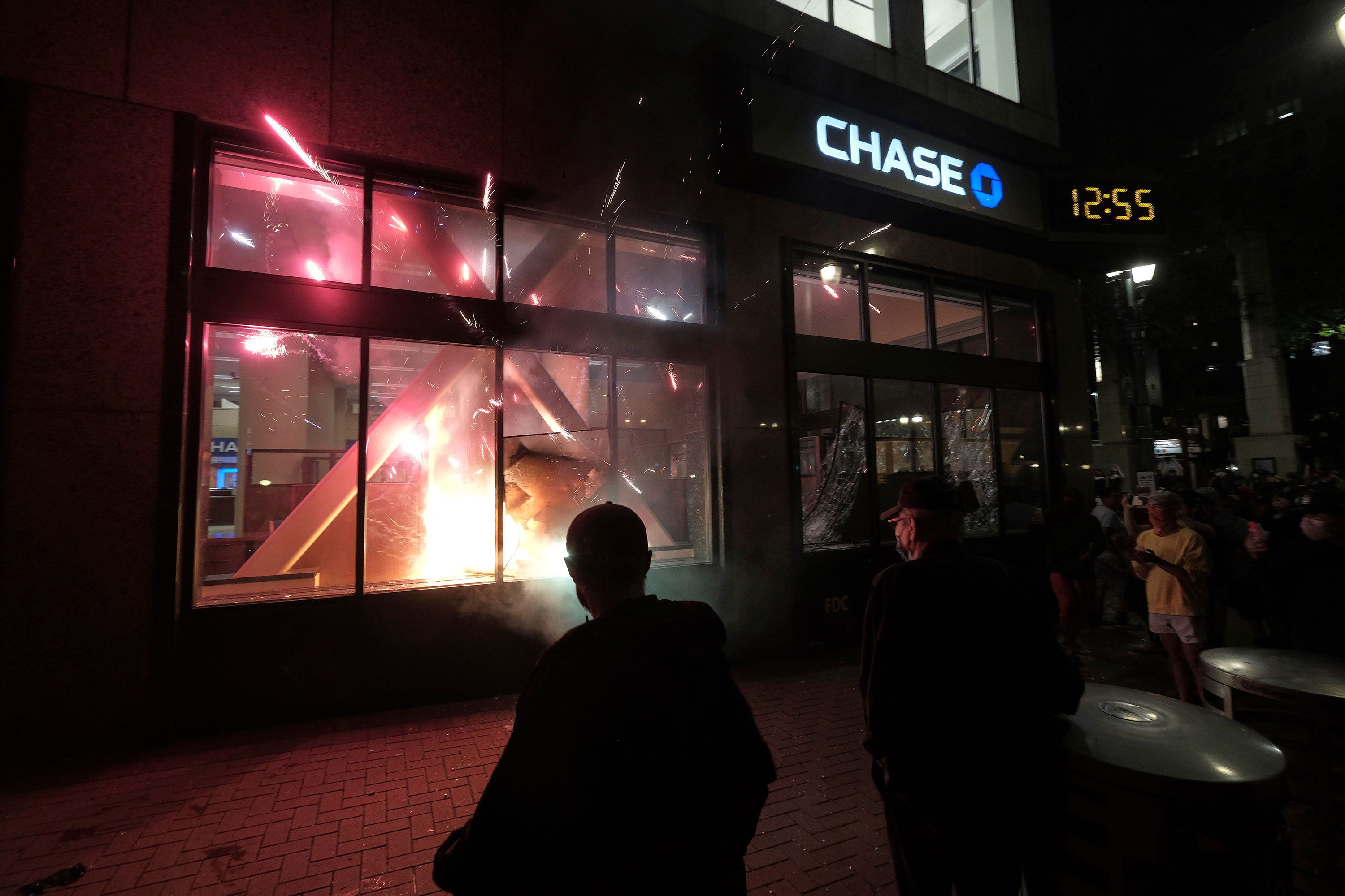 Protesters start a fire at a Chase bank in Portland, Oregon, on May 30.