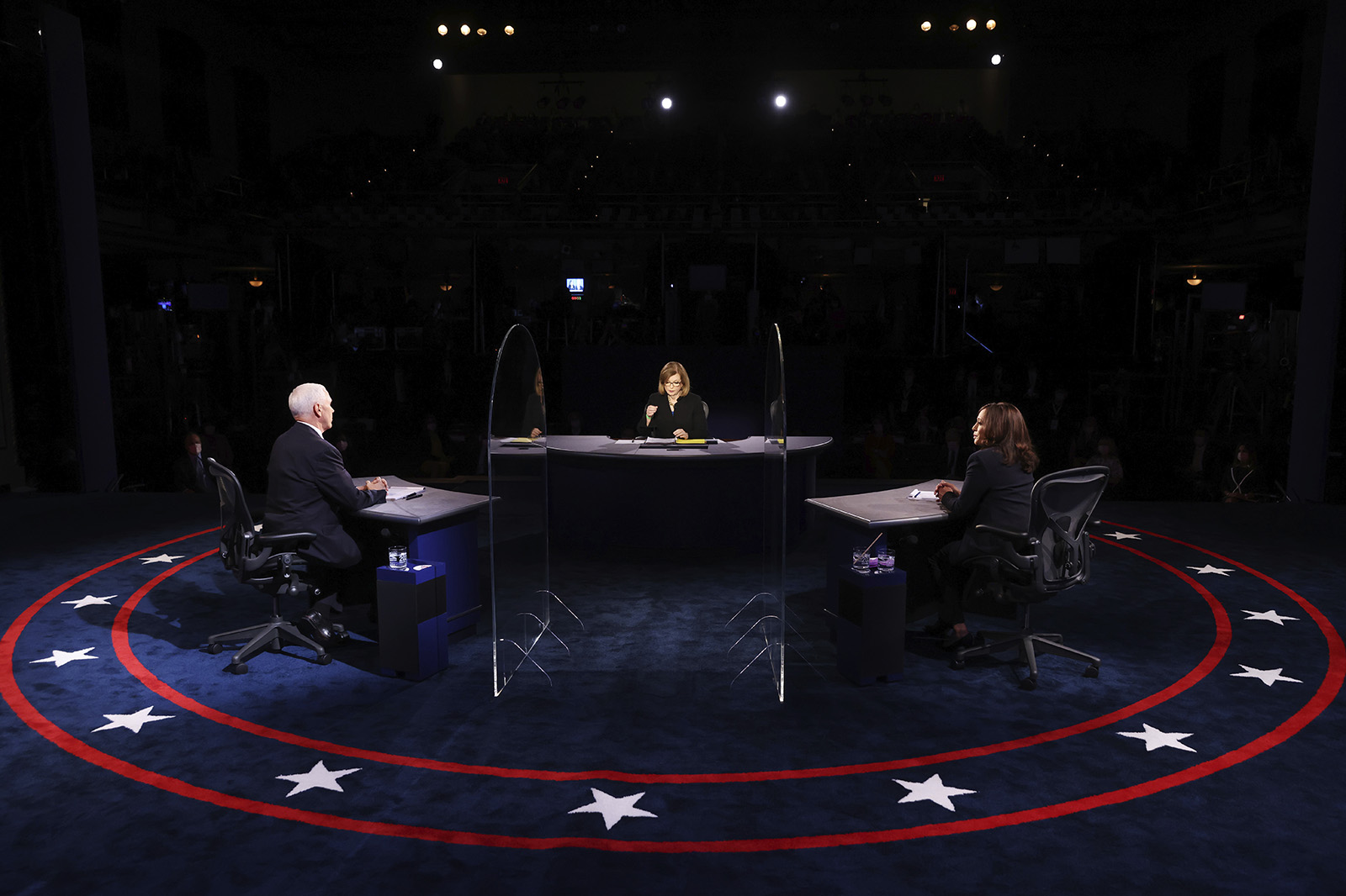 Vice President Mike Pence and Democratic vice presidential candidate Sen. Kamala Harris listens to a question from moderator USA Today Washington Bureau Chief Susan Page during the vice presidential debate on Wednesday in Salt Lake City.