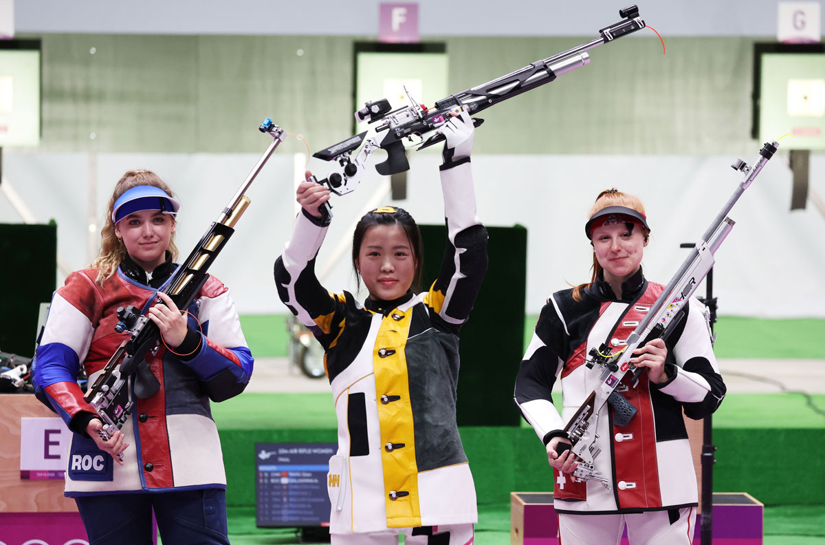 From left: Anastasiia Galashina of Russia, Yang Qian of China, and third-placed Nina Christen of Switzerland at the end of the 10m Air Rifle Women's Final.