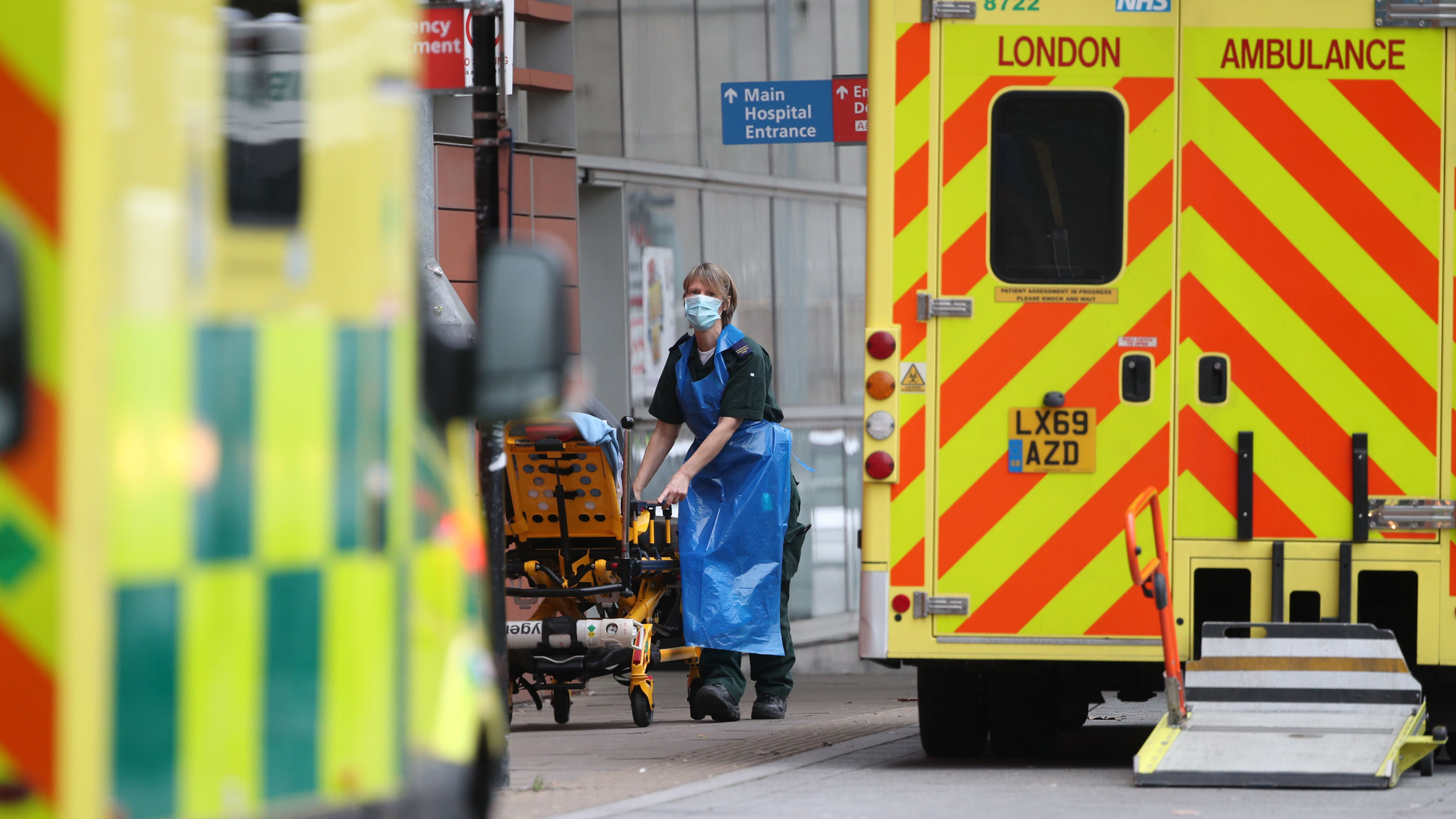 A paramedic wheels a gurney outside the Royal London Hospital on Thursday, January 21.