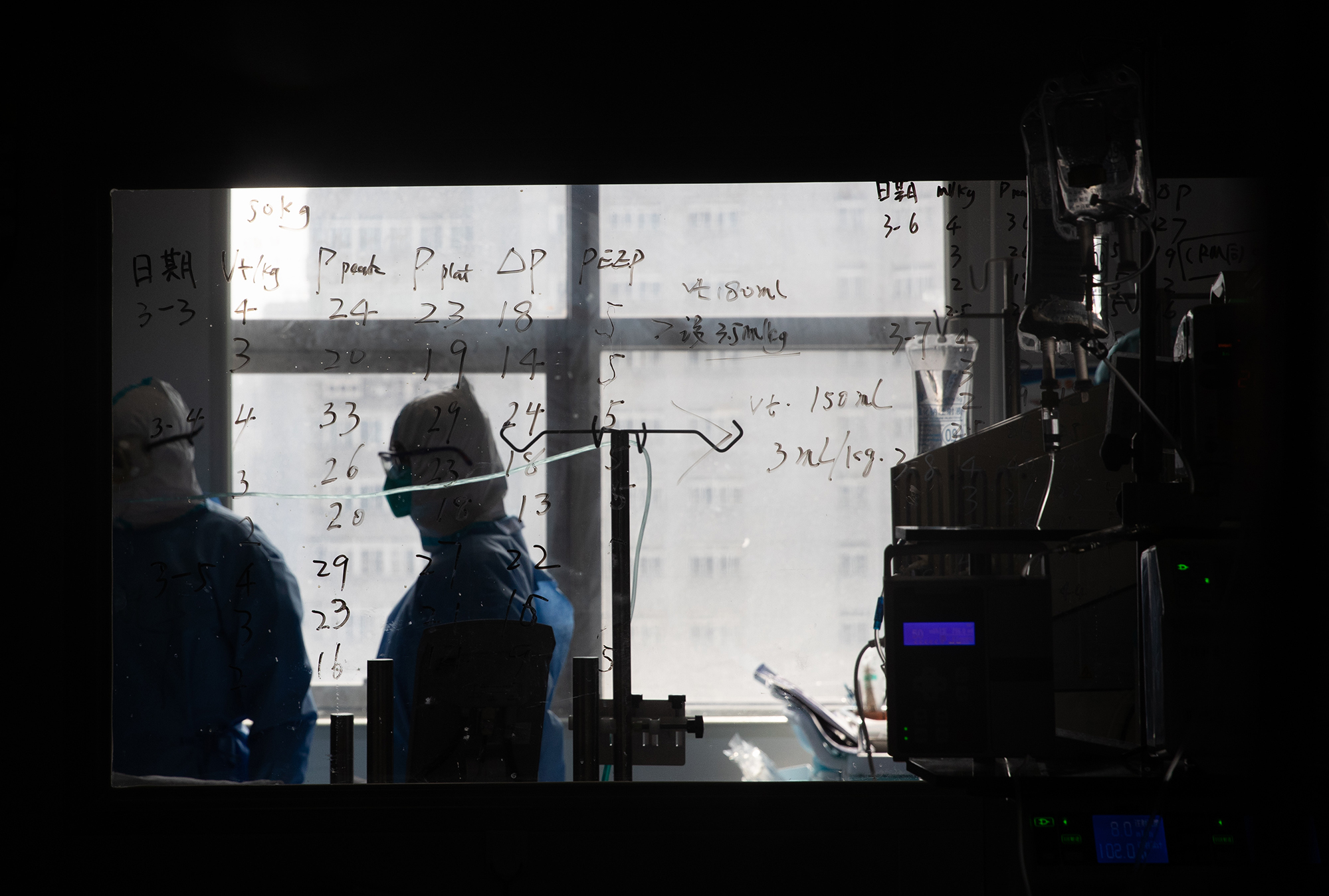 Medical information is seen on a window in a ward treating coronavirus patients at a hospital in Wuhan, in China's Hubei province, on March 19.