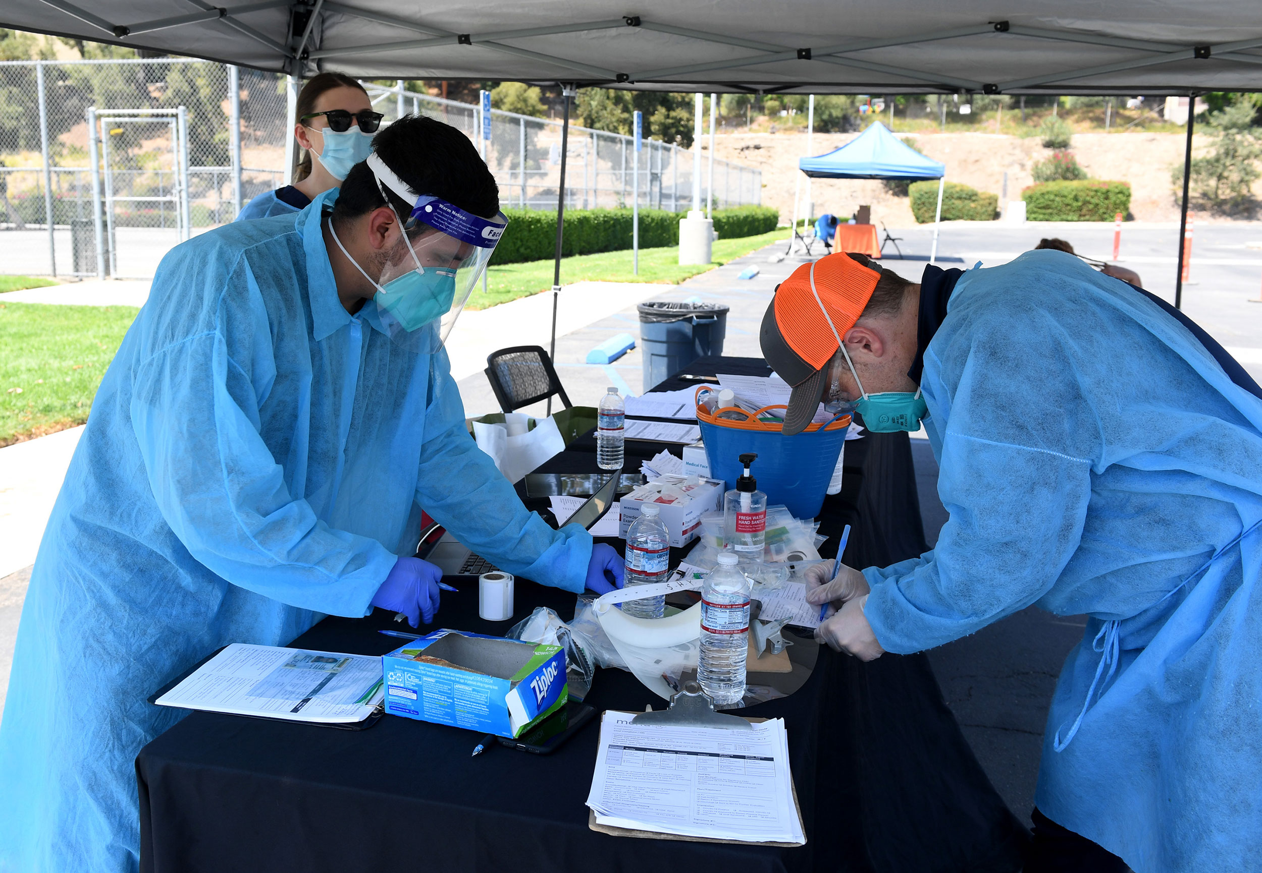 Mend Urgent Care workers perform drive-up Covid-19 testing at Woodbury University on August 24 in Burbank, California.