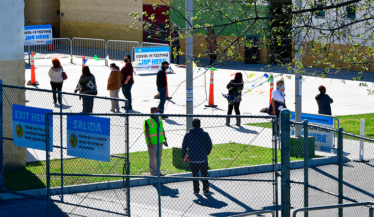 People line up for the first day of Covid-19 vaccinations at a site opened by the Los Angeles Unified School District for employees on February 17 in Los Angeles.