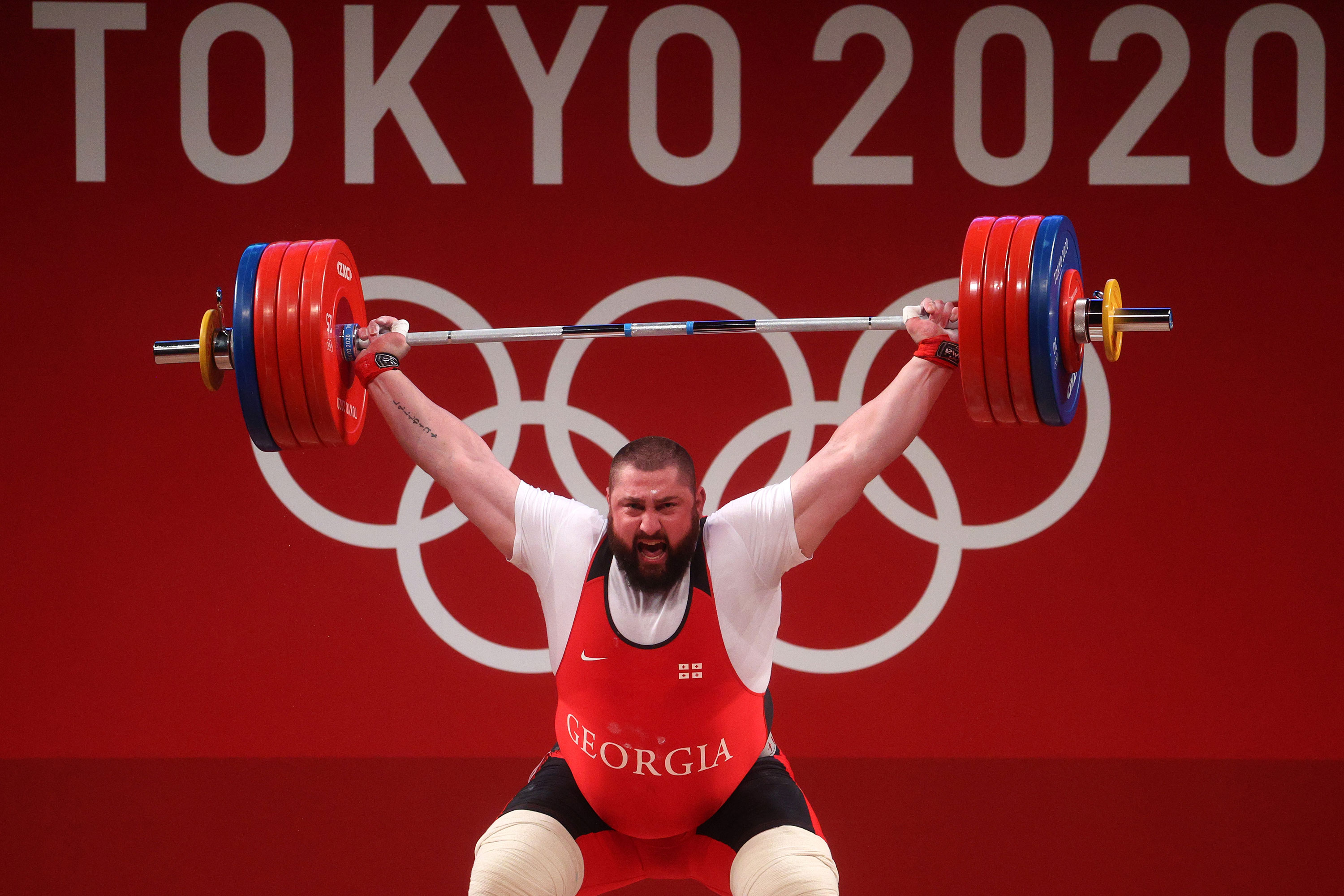 Lasha Talakhadze of Georgia competes during +109-kilogram weightlifting on August 4.