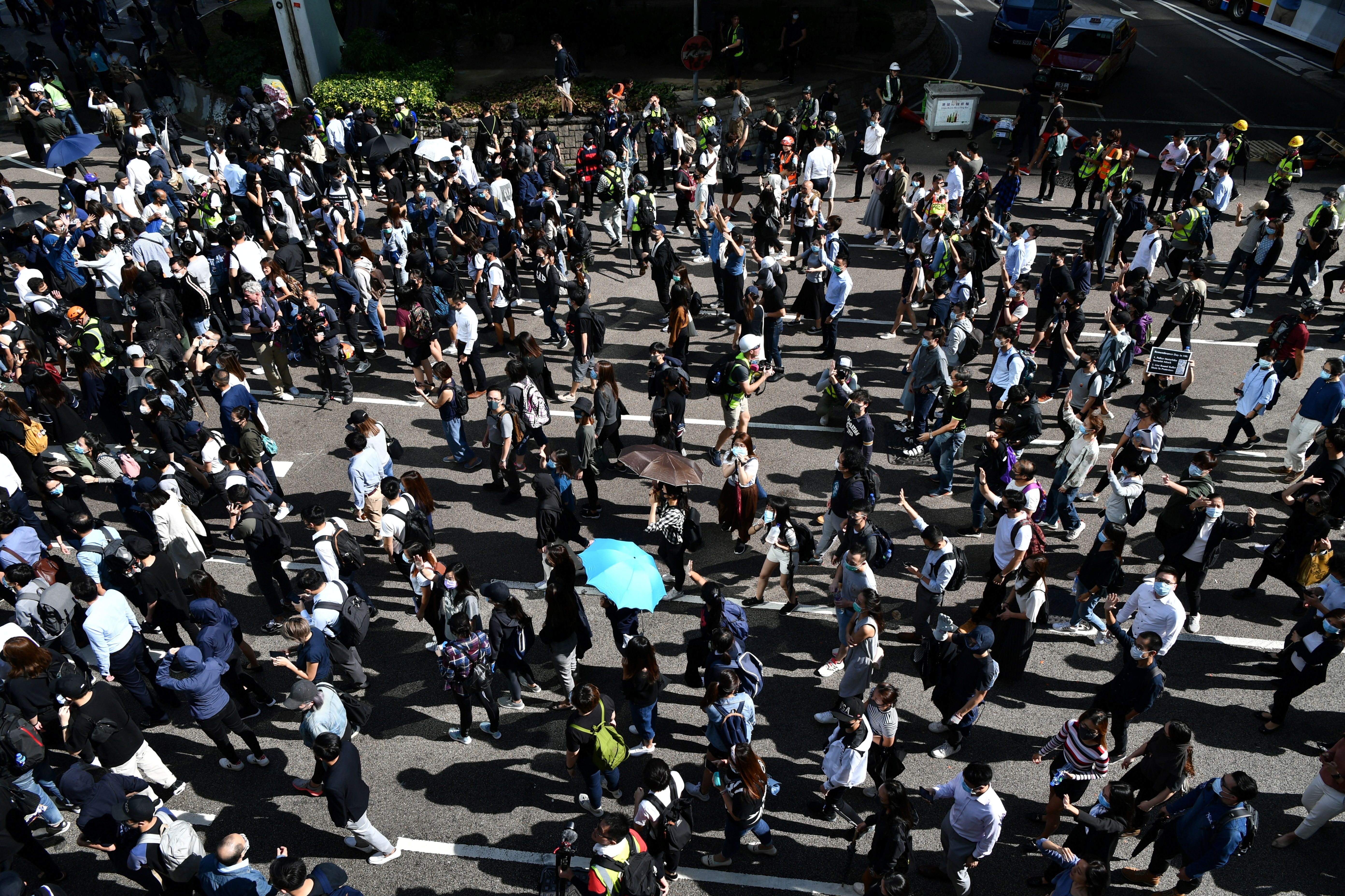 Demonstrators march along a main thoroughfare during a protest in Hong Kong's Central district.