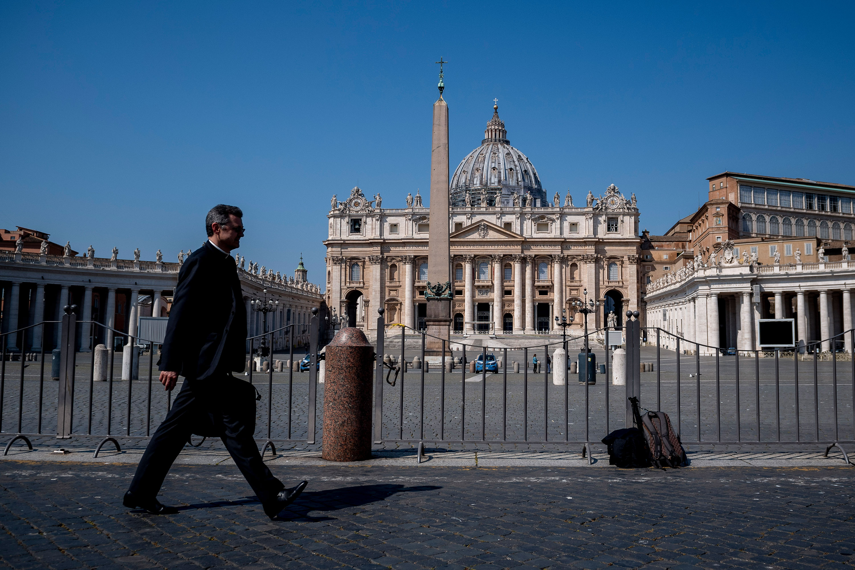 A priest walks in St. Peter's Square on April 12.