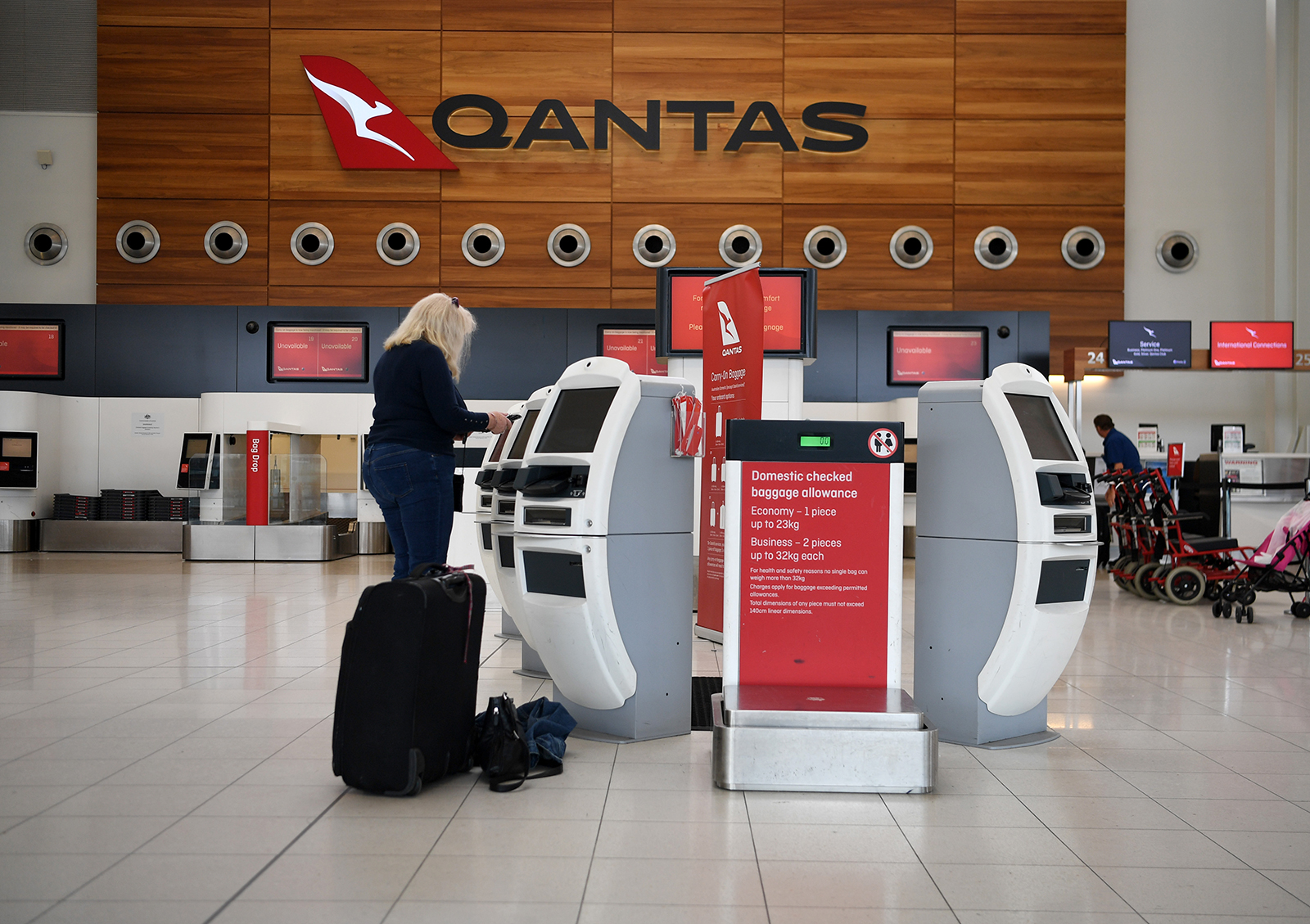Passengers check in for a Qantas flight at Adelaide Airport on April 1, in Adelaide, Australia.