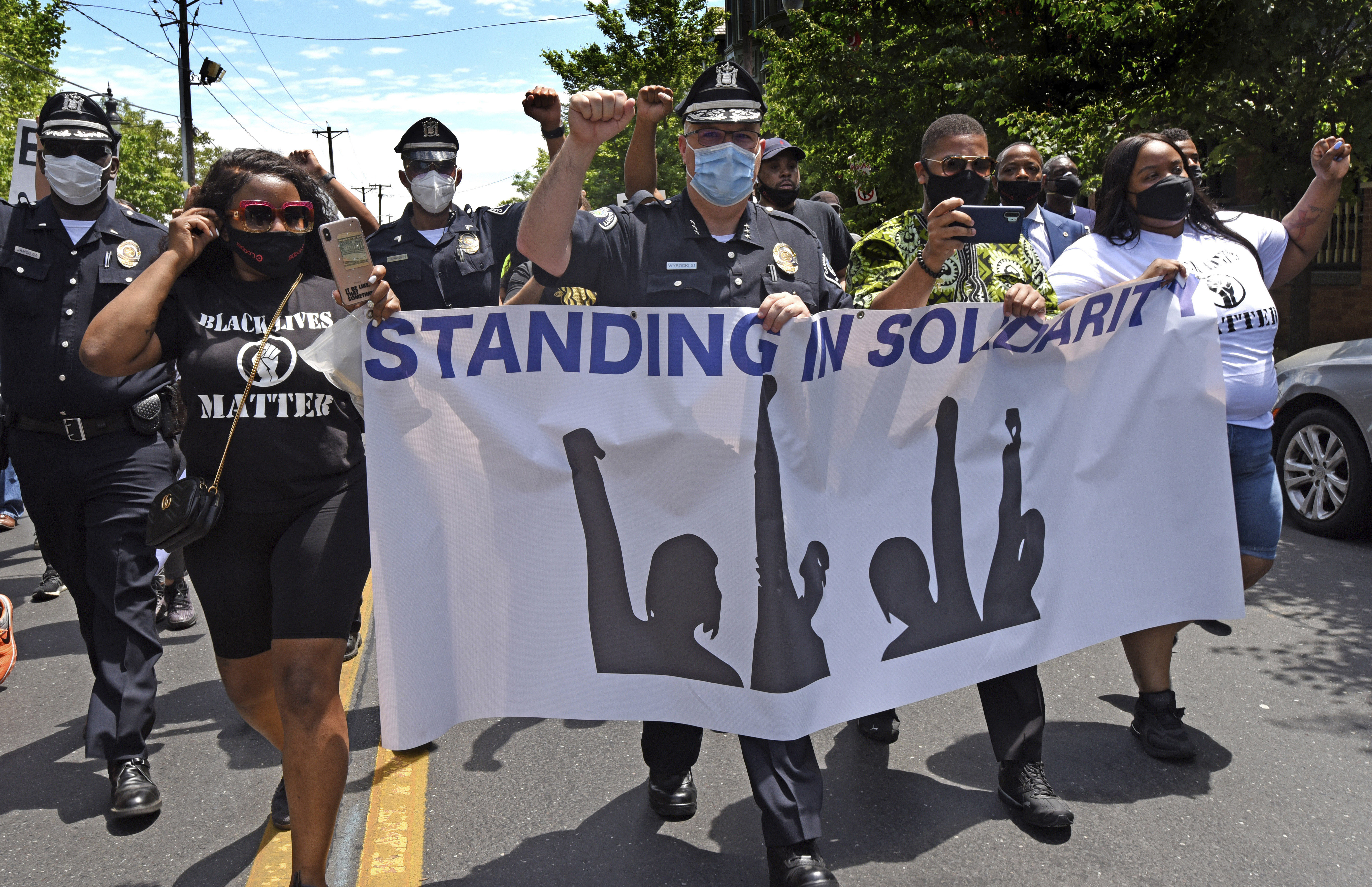 Camden County Chief of Police Joe Wysocki, center, marches with residents and activists in Camden, New Jersey, on May 30, during a protest against the death of George Floyd.
