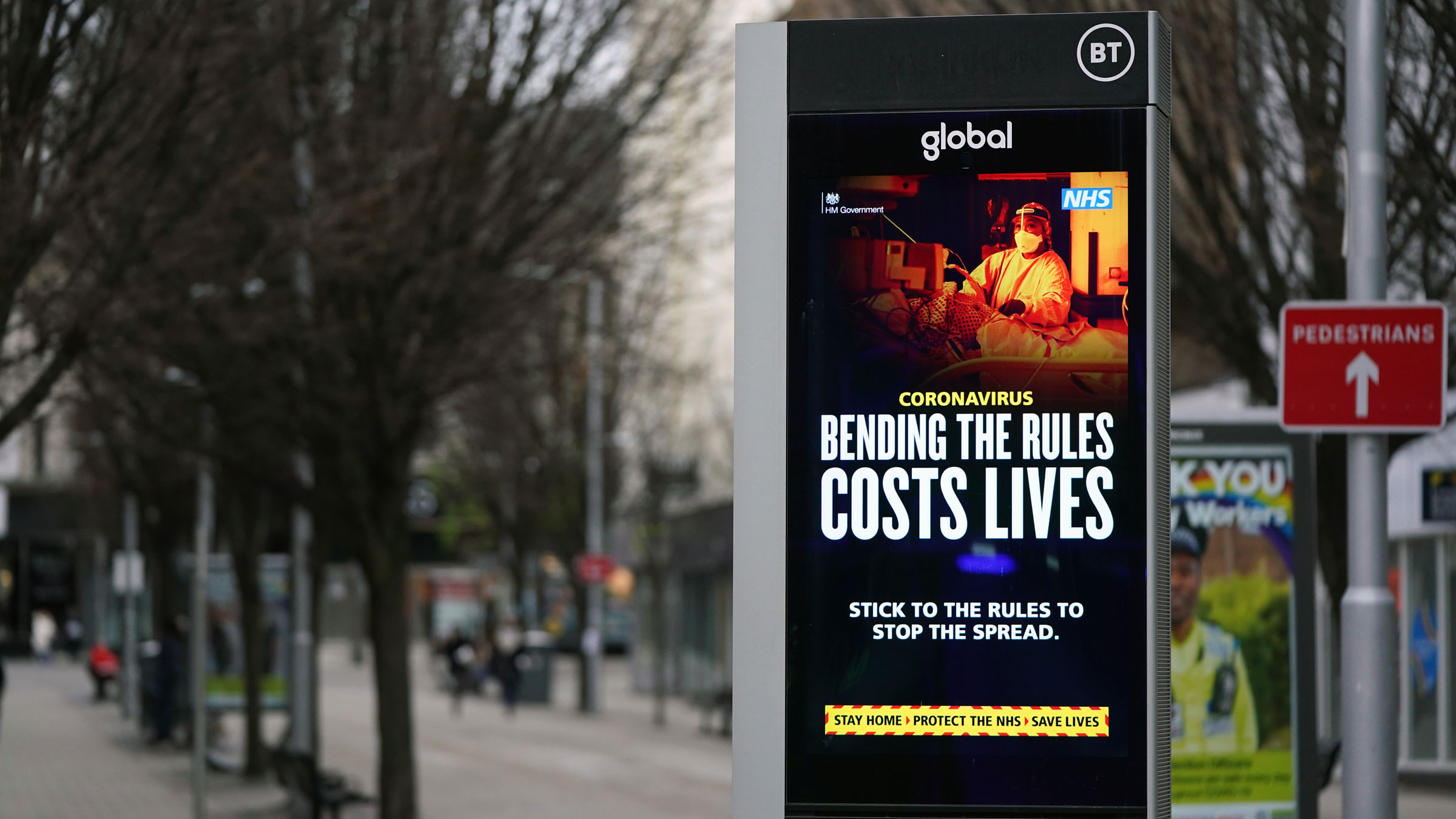 An electronic board warns people in Nottingham, England, on Monday.