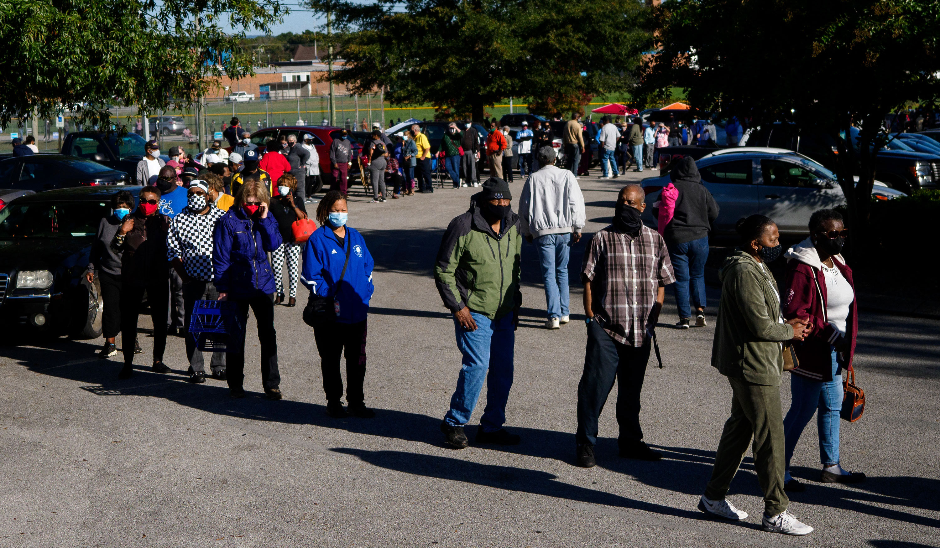Voters wait to vote in Chattanooga, Tennessee, on Wednesday, October 14. Early voting opened in Tennessee on Wednesday, and some people said they waited 90 minutes to just reach the entrance.