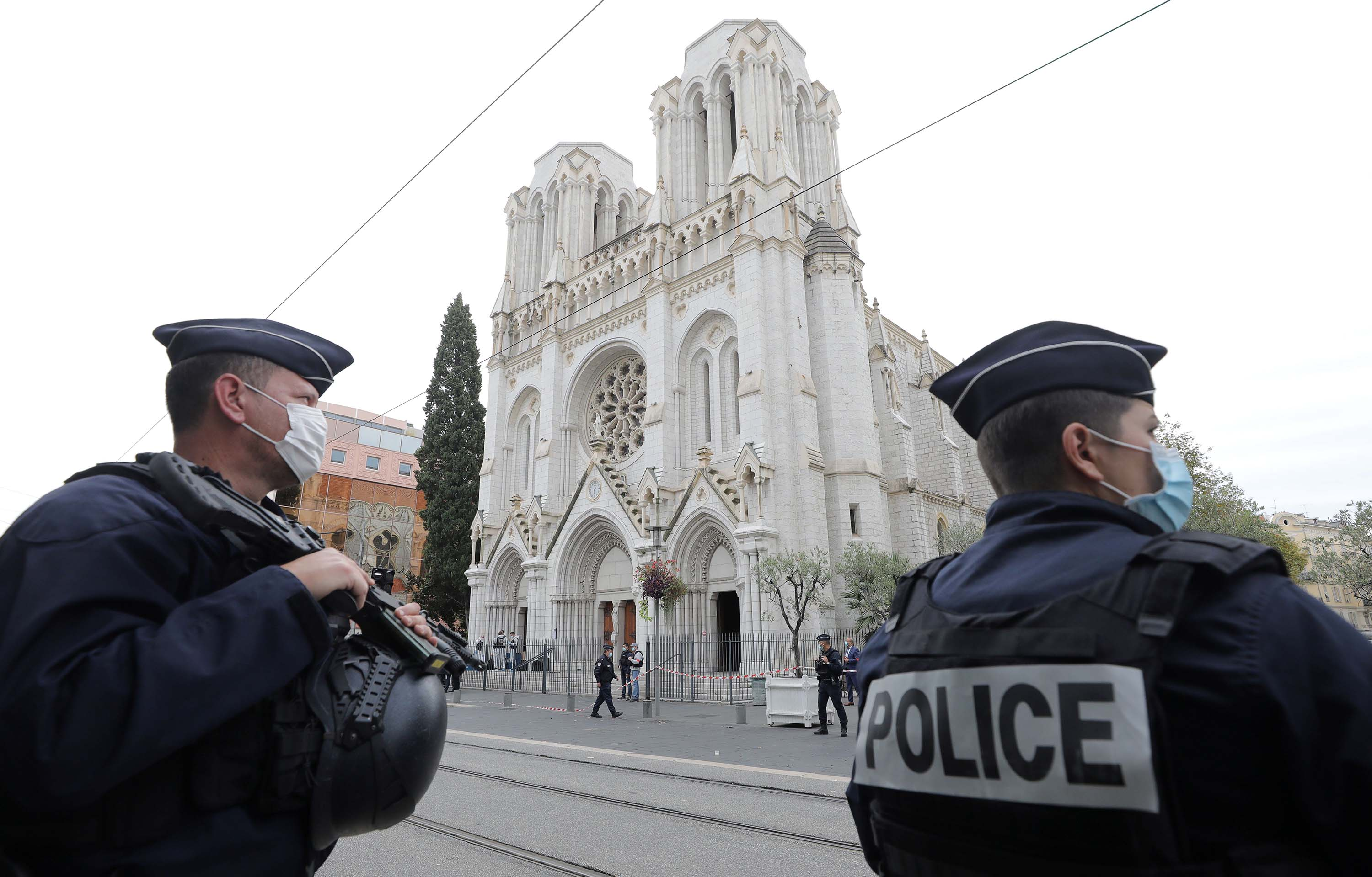 French policemen stand guard at the site of a knife attack at the Basilica of Notre-Dame de Nice on Thursday.