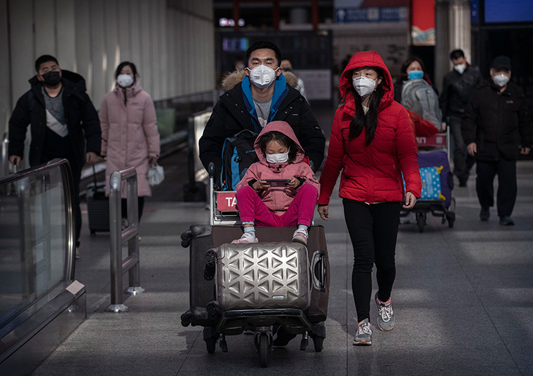 Passengers wear protective masks at Beijing Capital Airport on Thursday, January 30.