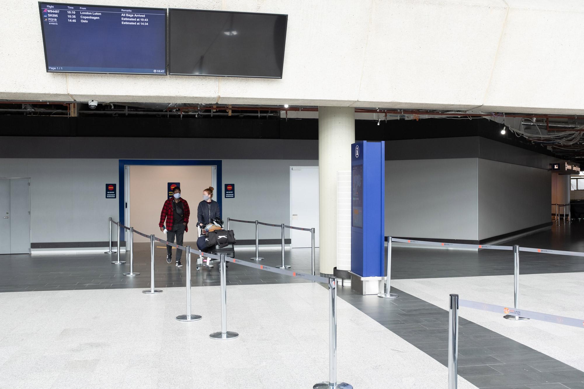 Passengers walk through Keflavík International Airport in Reykjanesbær, Iceland, on June 15.
