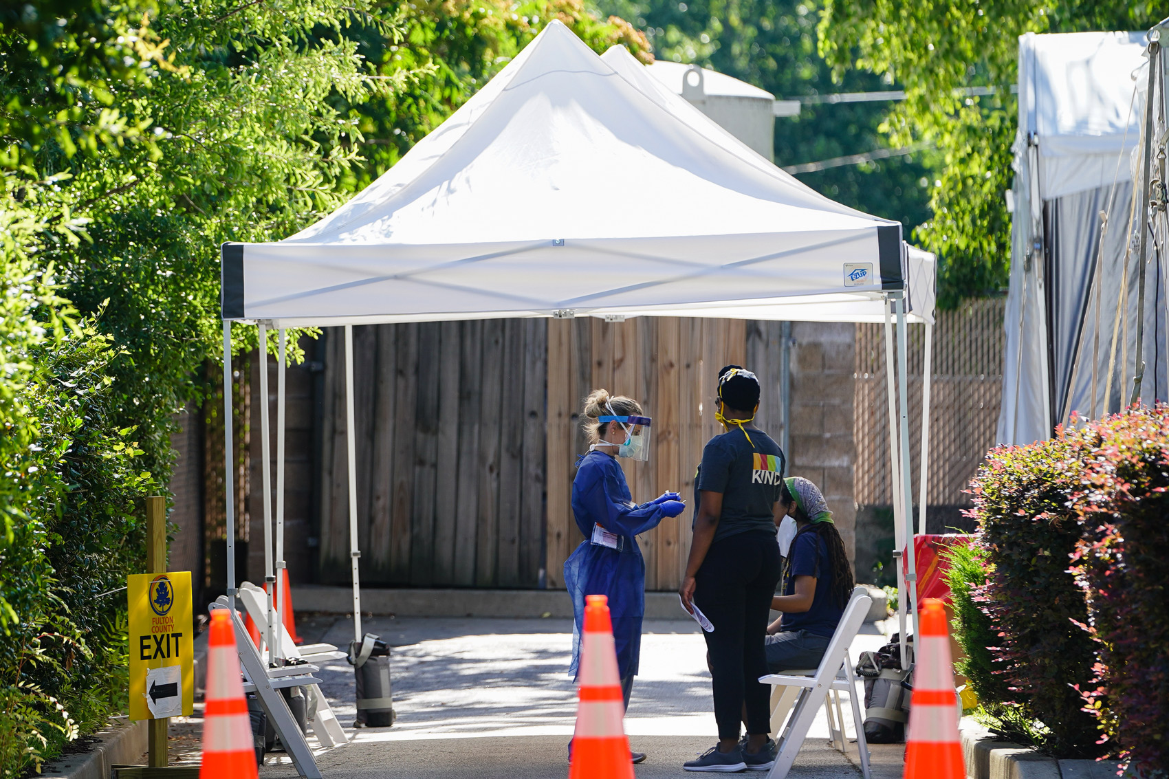 People get tested for COVID-19 at a free walk-up testing site on July 11 in Atlanta.