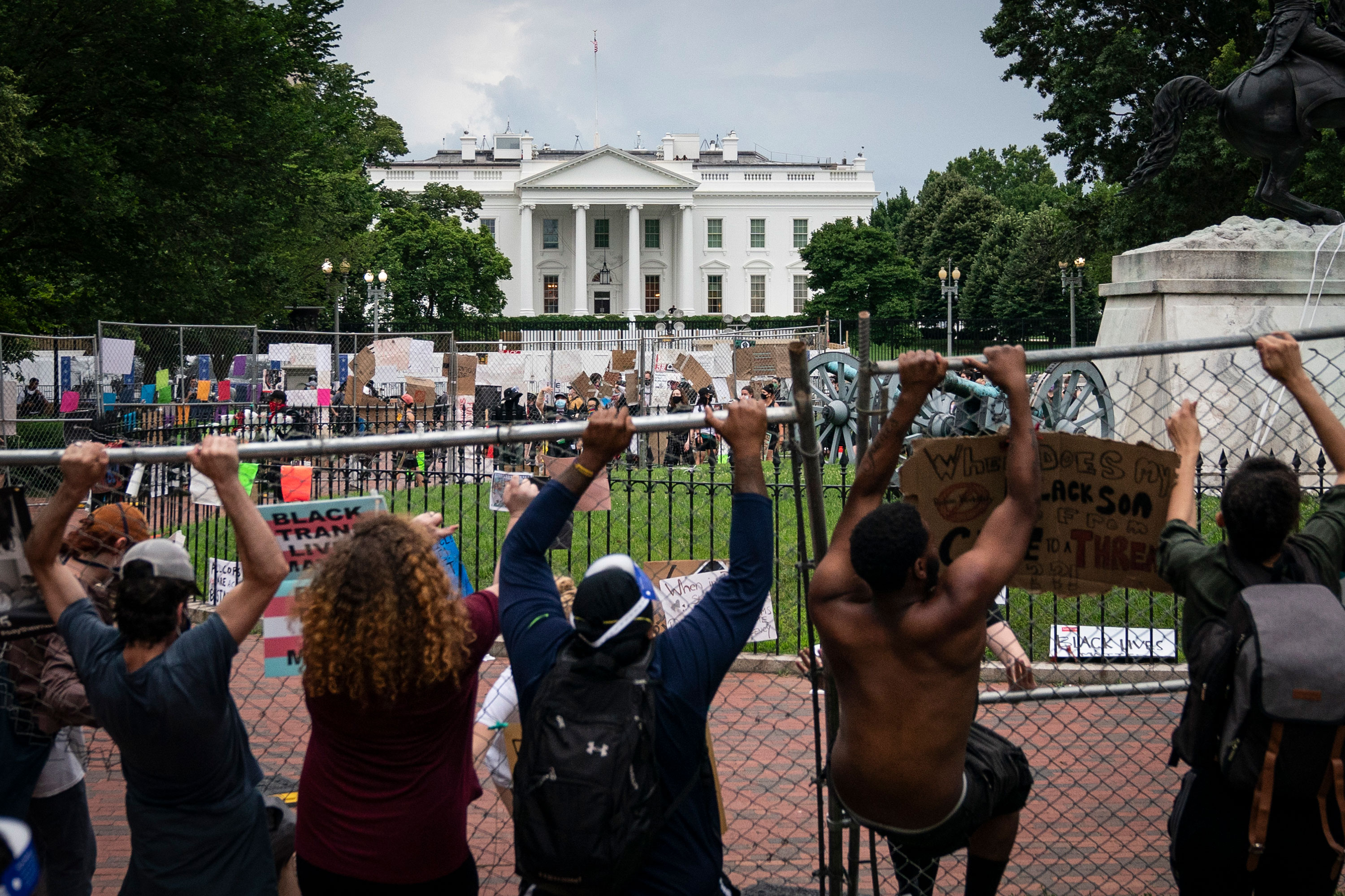 Protesters pull down a fence surrounding the statue of Andrew Jackson in Lafayette Square near the White House on June 22 in Washington.