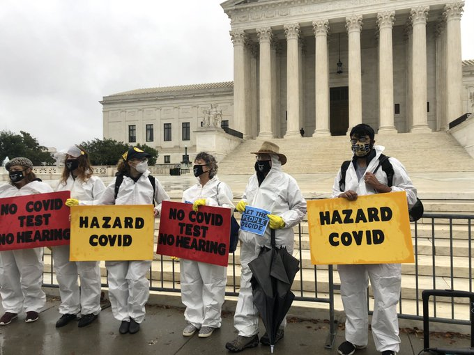 Organizers with Demand Justice protest outside the Supreme Court on Monday.
