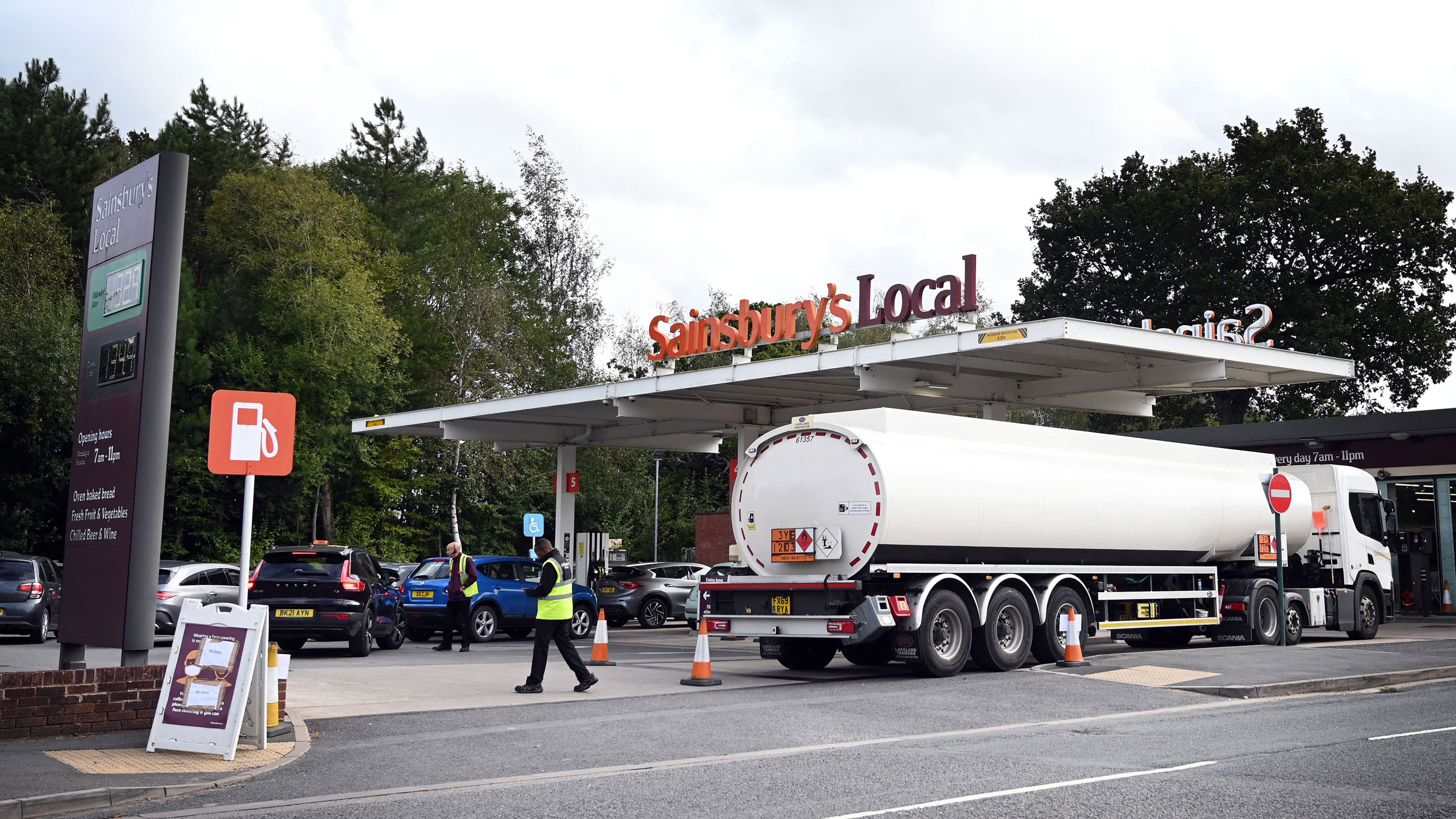 A fuel tanker arrives to replenish stocks at a gas station in Coventry, England, on Tuesday.
