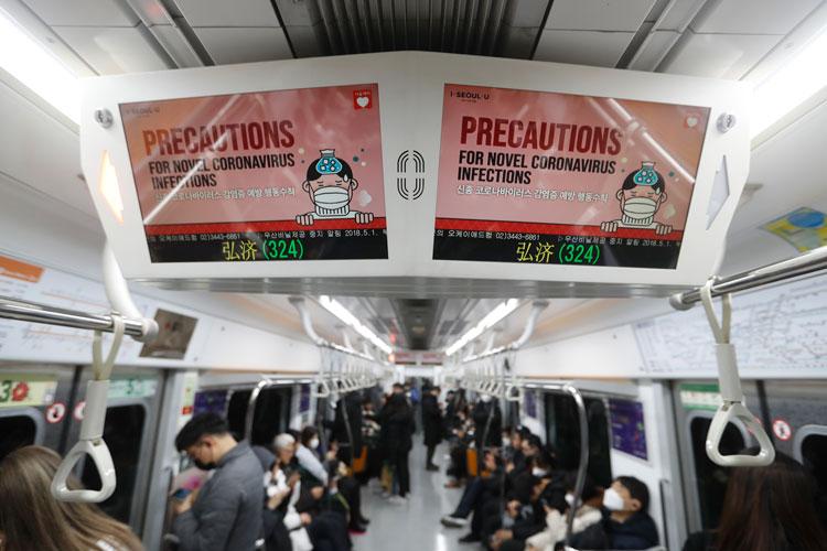 Electric screens announce precautions against the coronavirus on a subway train in Seoul, South Korea, on Monday, February 17.