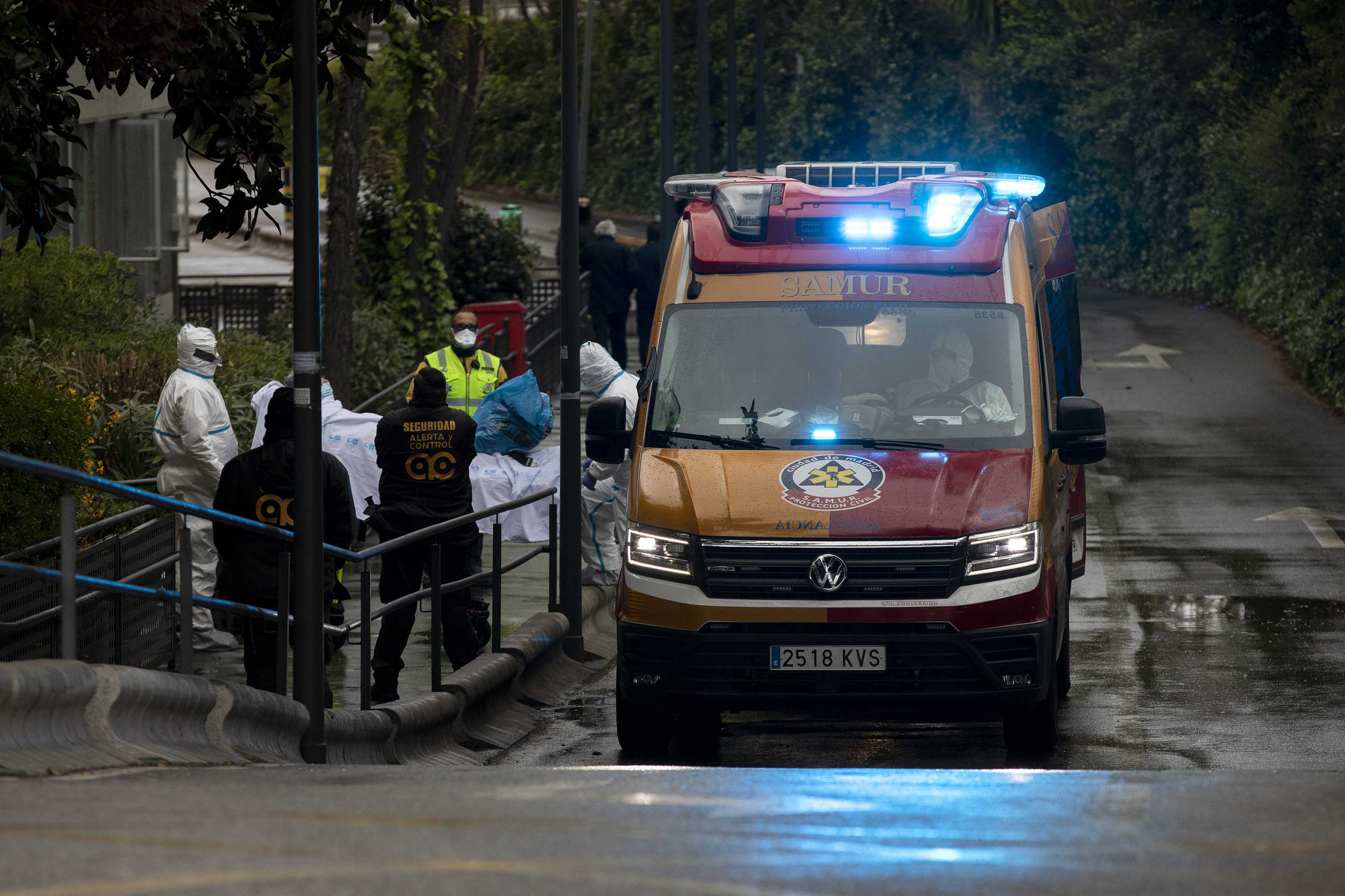 Medical staff move a patient into an ambulance at La Paz Hospital on March 16, in Madrid, Spain.