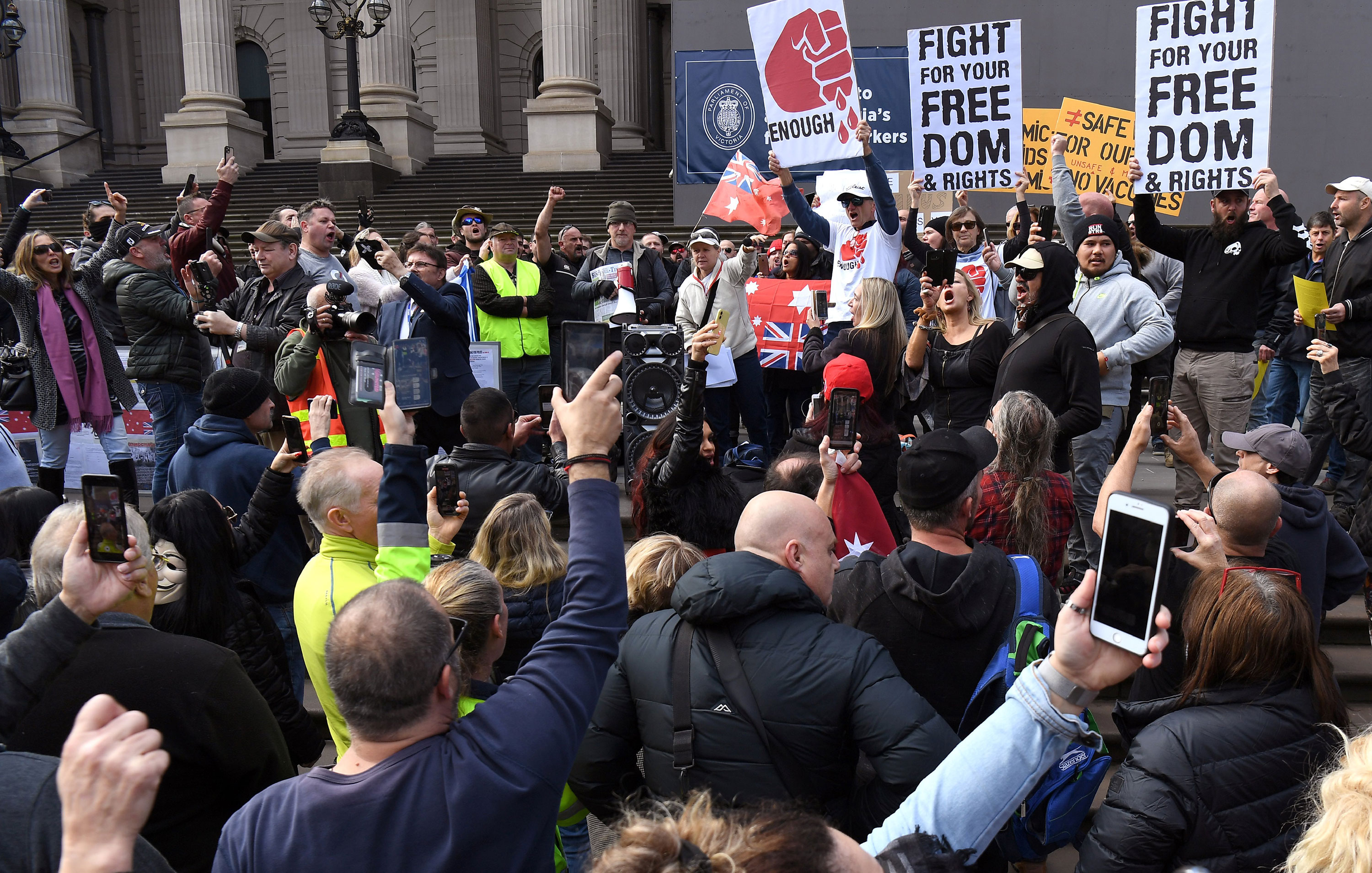 Anti-lockdown protesters chant on the steps of Parliament House in Melbourne, Australia, on May 10.