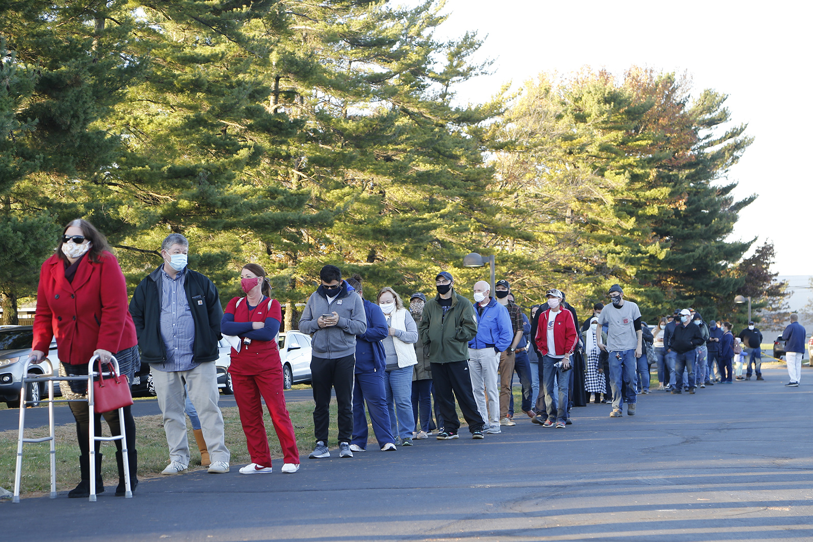 People stand in line to vote outside Maranatha Baptist Church on Tuesday in Columbus, Ohio.