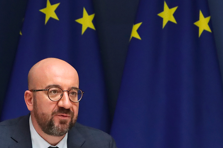 European Council President Charles Michel speaks with EU leaders, via videoconference link, during a EU summit at the European Council building in Brussels, Thursday, March 25.