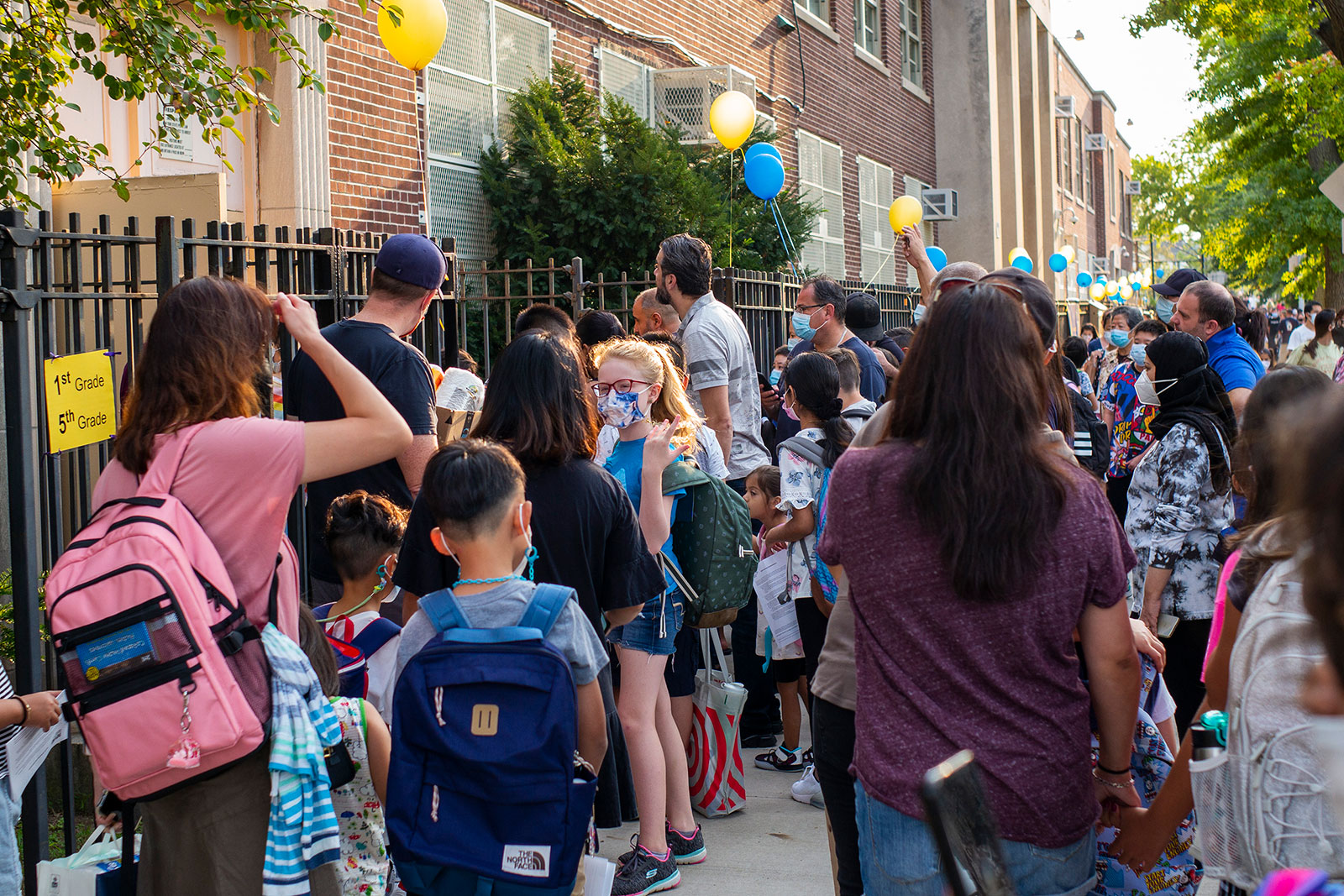 Students enter a public school in Queens, New York, on September 13.