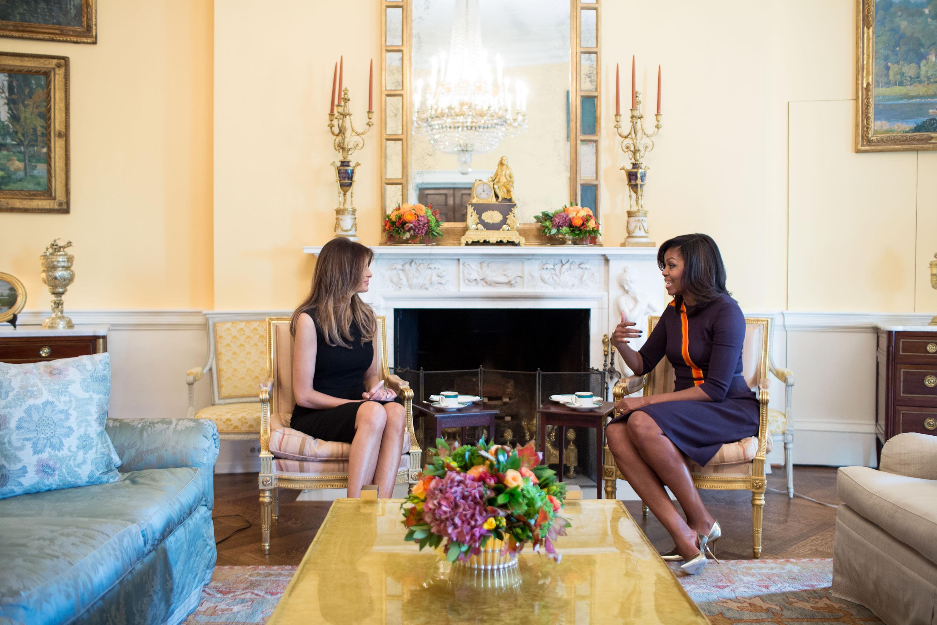 Michelle Obama meets with Melania Trump for tea in the Yellow Oval Room of the White House on November 10, 2016.