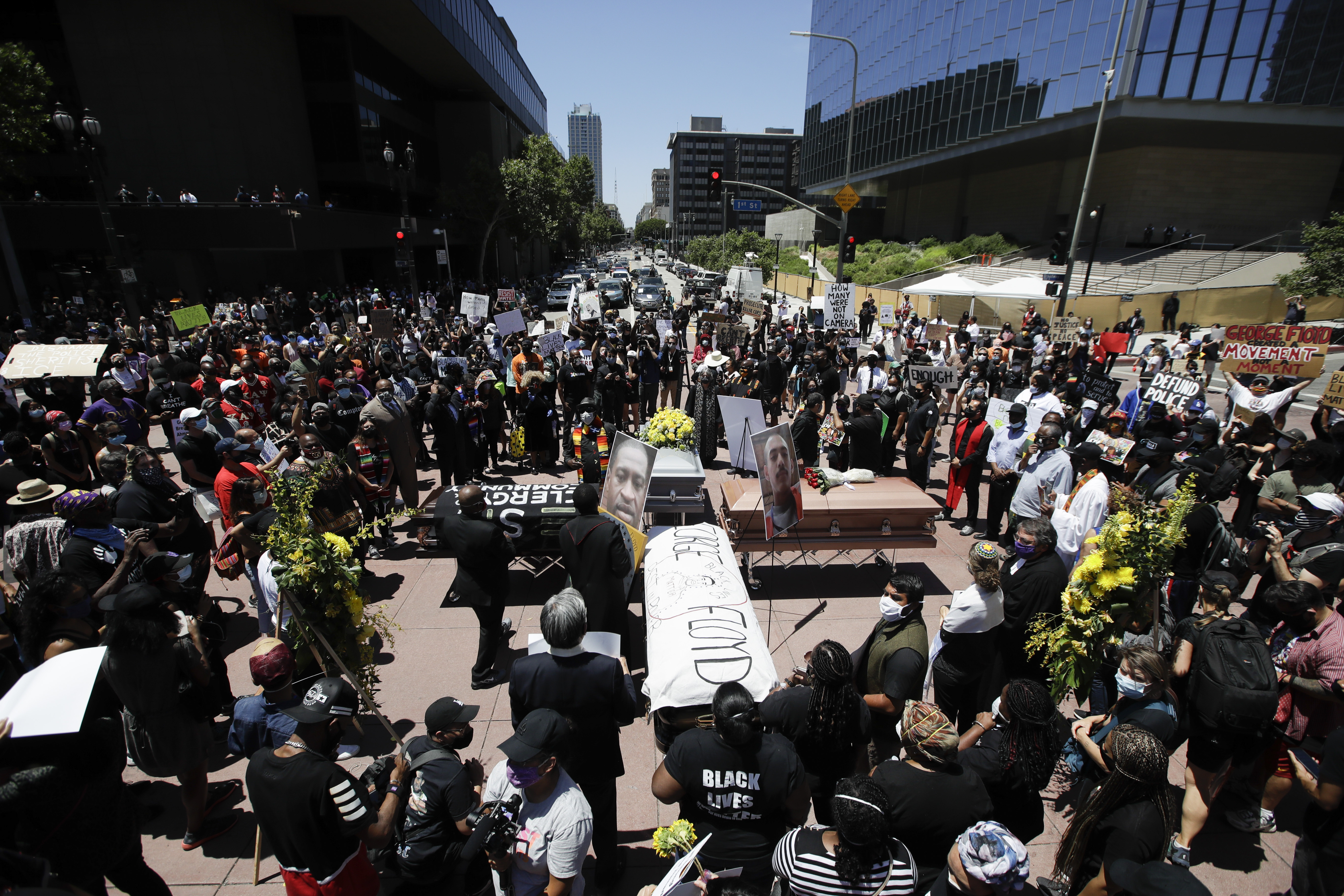 Caskets are laid out in the shape of a cross on June 8, in Los Angeles during a protest over the death of George Floyd.